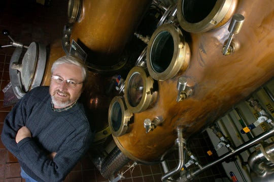 MSU Distinguished Professor of Chemical Engineering Kris Berglund shows the large copper still at MSU's Food Science Building that is used for distilling in the Artisan Distilling Program in 2005. Berglund died on Dec. 13, 2018.
