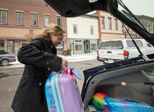 """""""We've just been evacuated and I probably shouldn't be smiling, but tomorrow I'm headed to Hawaii,"""" Portland resident Jeney Vroman said Friday, Feb. 8, 2019, while loading her car with luggage after being forced to evacuate her apartment on Kent Street.  """"We'll deal with whatever damage is done when we get back."""""""