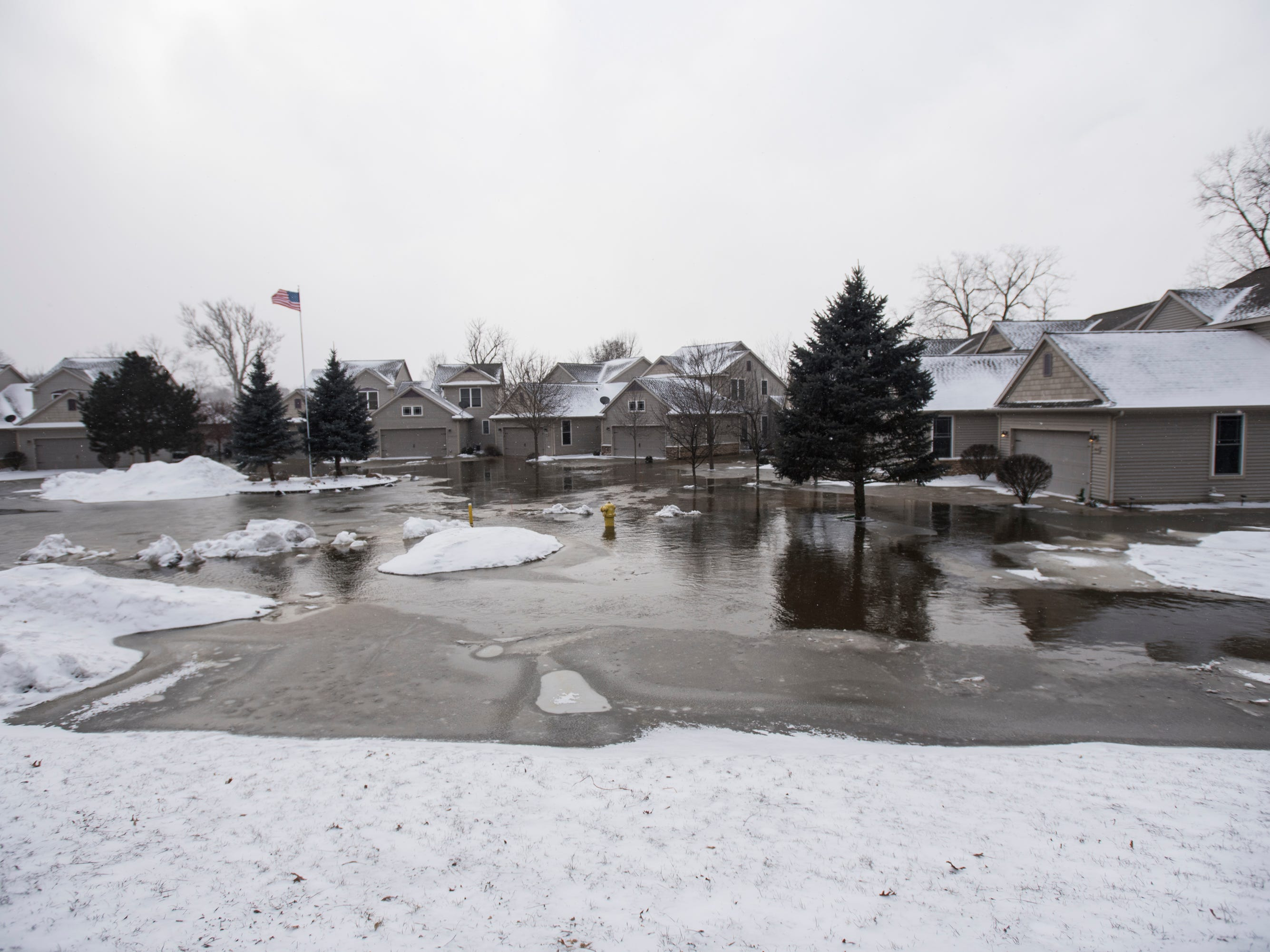 Homes near the mouth of the Looking Glass and Grand River are under water Friday, Feb. 8, 2019.  [Matthew Dae Smith/Lansing State Journal]