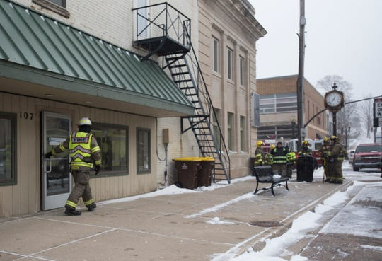 Firefighters went door-to-door Friday afternoon at businesses and residences in downtown Portland to notify them of a flooding emergency. Ice built up in the Grand River promoted officials to close three bridges.