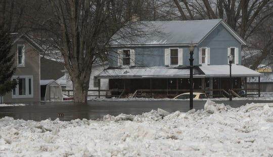Homes along River Street near Grand River Avenue in downtown Portland are underwater as ice jams and rising water have caused flooding in low lying areas on Friday, February 8, 2019.  More residents and businesses have been vacated.