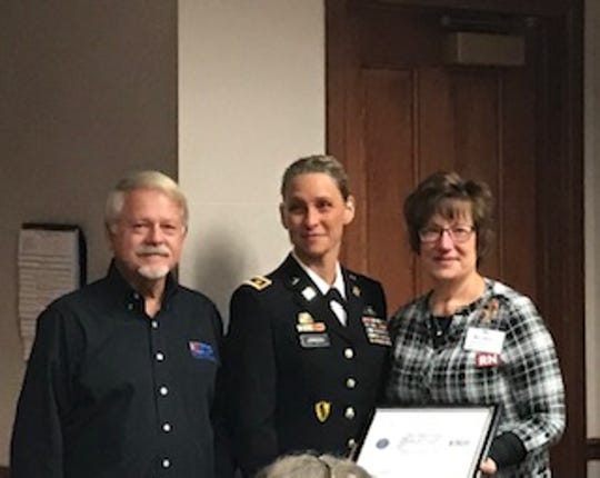 Mary Beth Larsen, the emergency services manager at Aurora Medical Center in Manitowoc County, was presented with the Patriot Award on behalf of the Employer Support of Guard and Reserve. Pictured are Larsen with Jenise Jorsch and presenter Ed Hansen, a volunteer with ESGR.