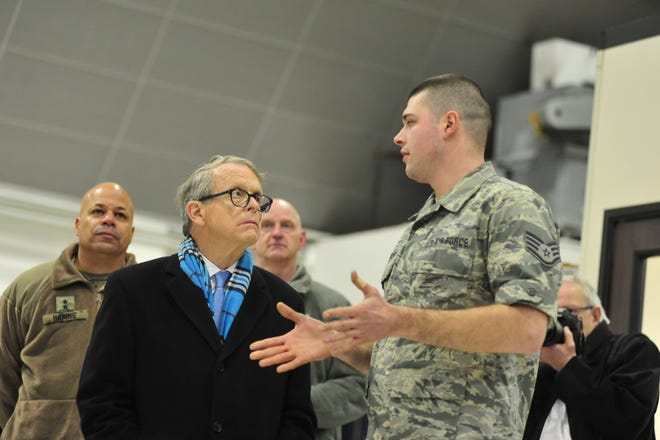 Ohio Gov. Mike DeWine is briefed by Staff Sgt. Nathaniel Winkler of the 179th Air Wing Maintenance Group.
