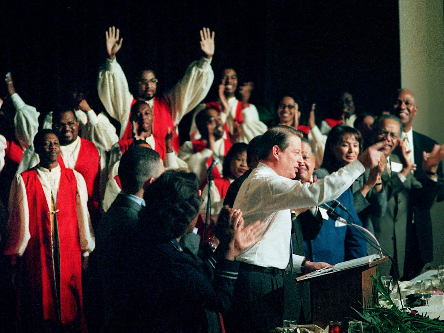 Al Gore, center, addresses a crowd during the Tennessee Democratic Victory Interfaith Prayer Breakfast at the Peabody Hotel in Memphis on Nov. 4, 2001. Flanking Gore at the event are, among others, his wife Tipper, Rep. Harold Ford, Jr., D-Tenn., and Martin Luther King III.