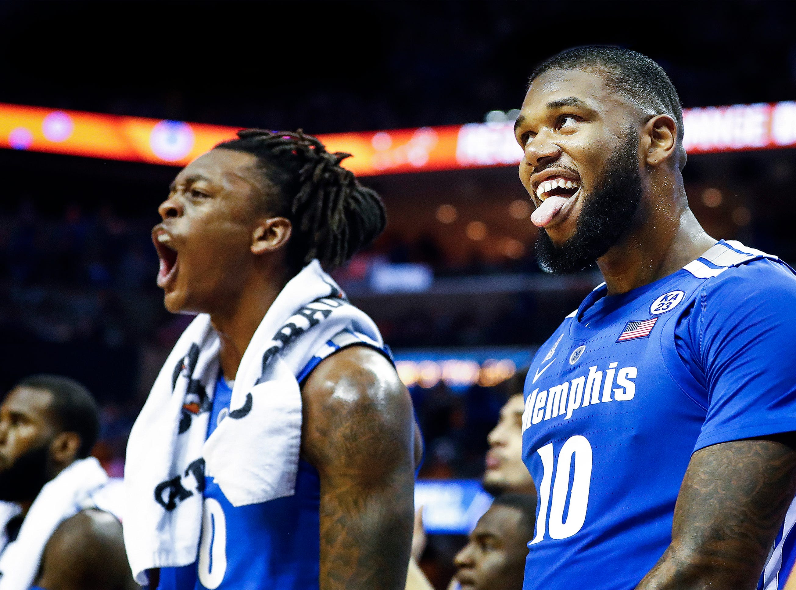 Memphis teammates Kyvon Davenport and Mike Parks Jr. (right) celebrate on the bench during action against Tennessee during action at the FedExForum, Saturday, December 15, 2018.