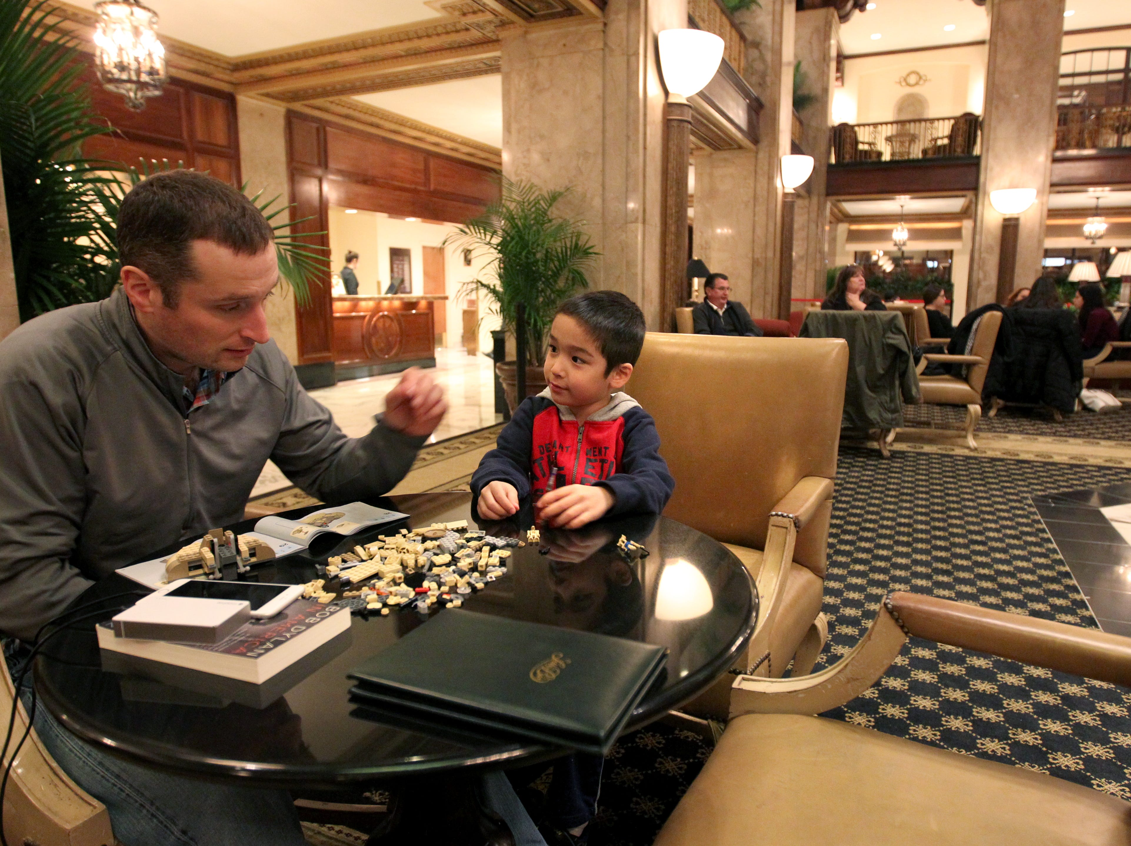 Hotel guests Matt Frantzen entertains his son, Henry Frantzen, 6, with Legos in the lobby at the Peabody Hotel during their stay in Memphis on Feb. 16, 2015. Memphis area hotels had the highest occupancy rate in more the 25 years in 2014.