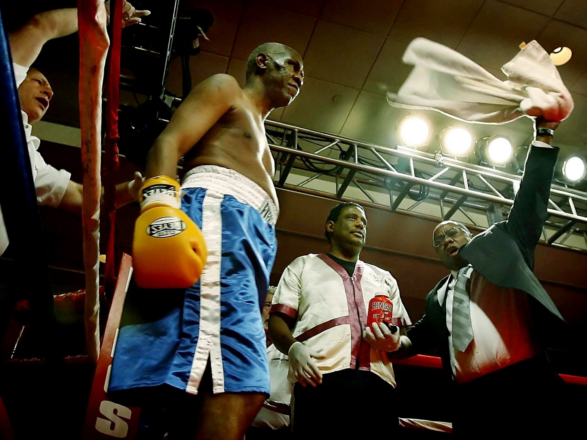 Memphis Mayor Willie Herenton, 66, middle, and his corner get pumped up before his benefit boxing match against Joe Frazier at the Peabody Hotel in Nov. 30, 2006.