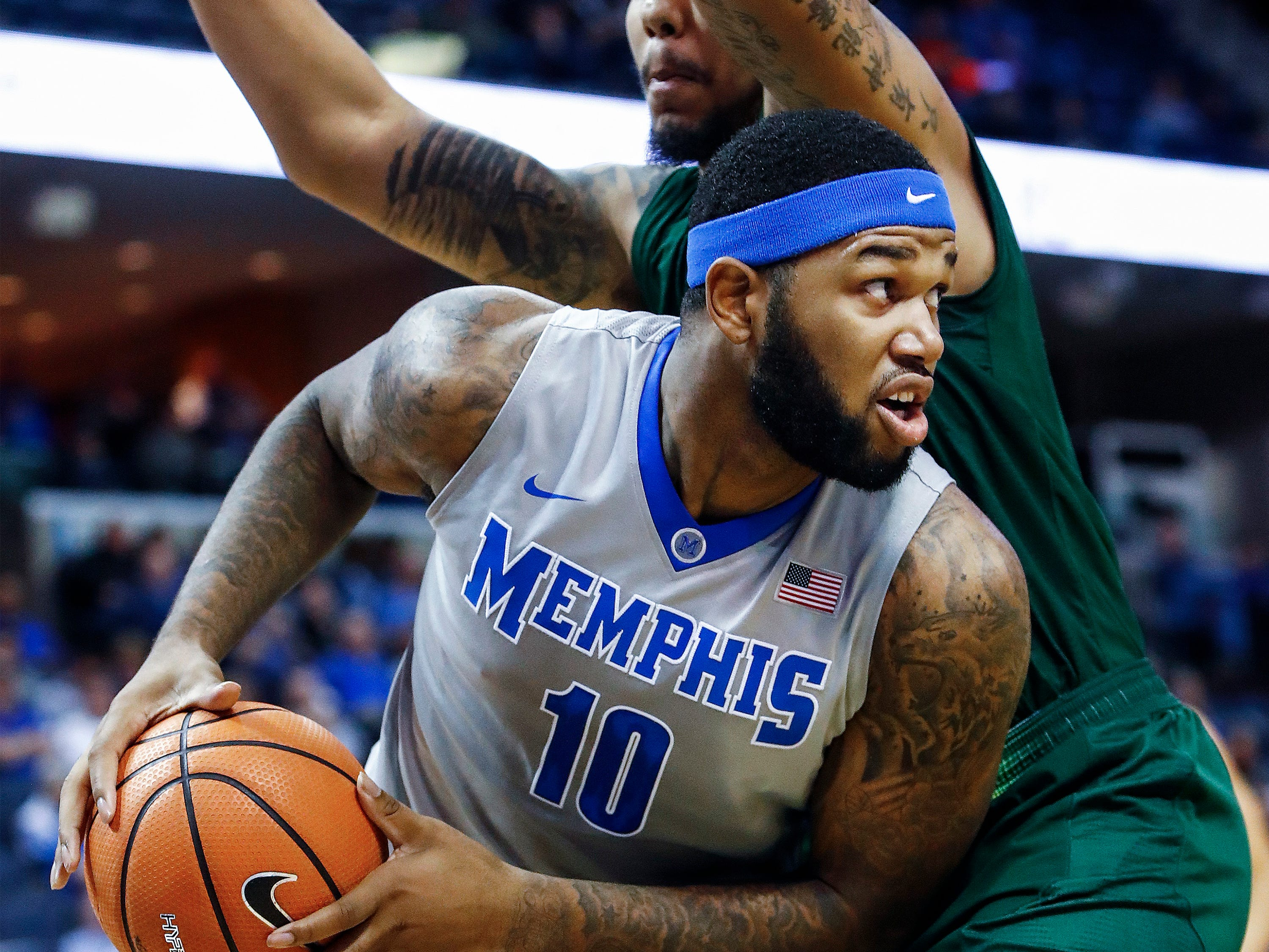 Memphis forward Mike Parks Jr. (left) looks for an outlet pass against the USF defense during first half action at the FedExForum in Memphis Tenn., Thursday, March 1, 2018.