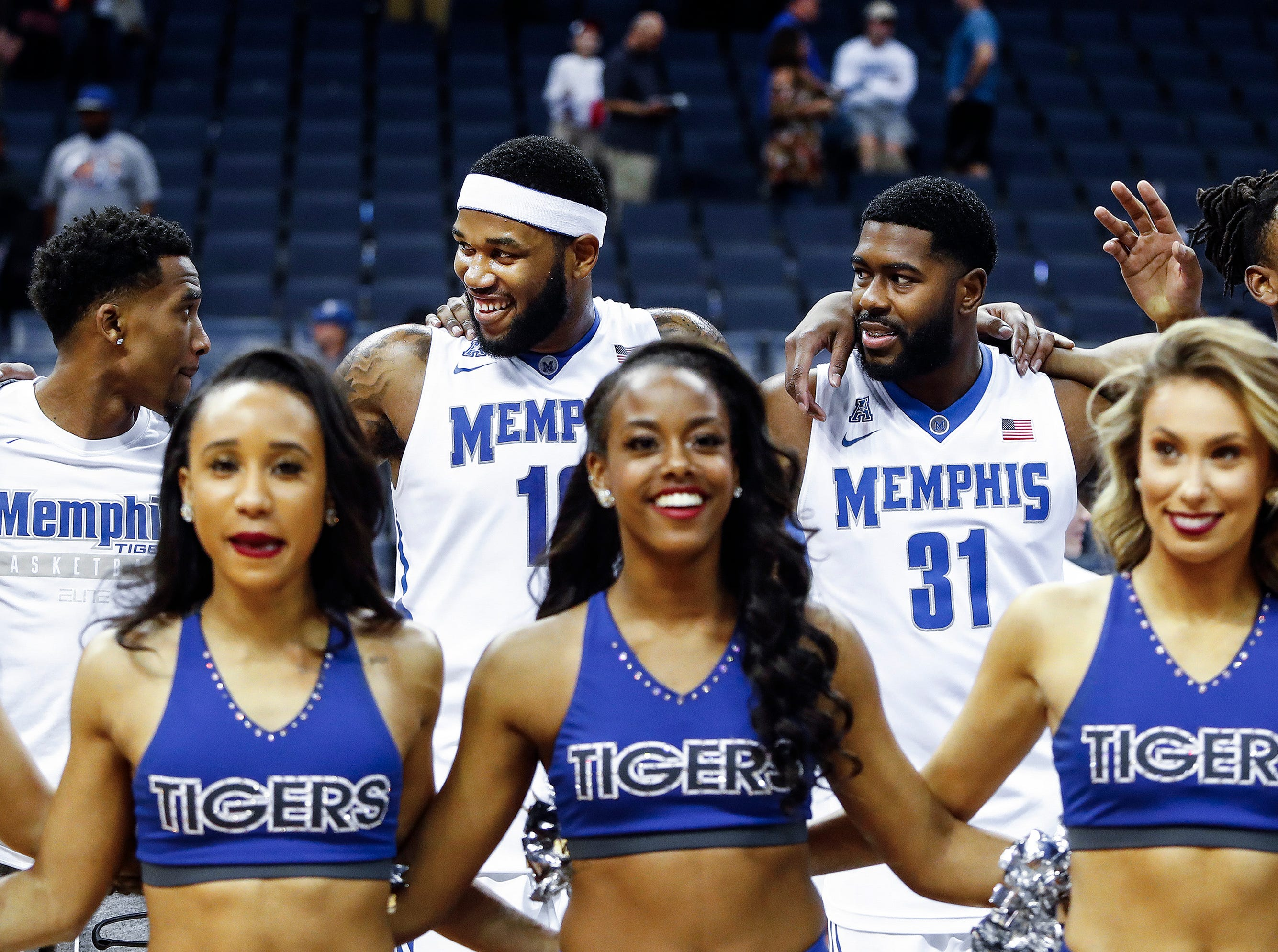 Memphis teammates (left to right) Jeremiah Martin, Mike Parks Jr., Jesse Johnson, and Kyvon Davenport celebrate a 90-70 victory over ECU at the FedExForum in Memphis Tenn., Sunday, March 4, 2018.