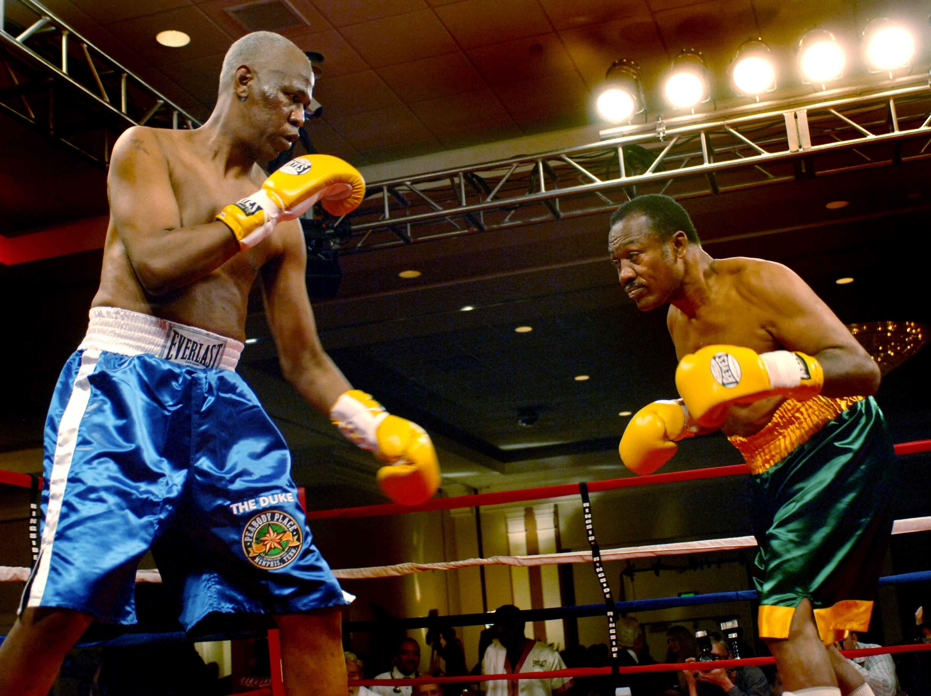 Memphis Mayor Willie Herenton, left, reaches in to former heavyweight champion Joe Frazier, right, during their charity bout at the Peabody Hotel on Nov. 30, 2006. Neither boxer landed any punches in the three-one minute rounds.
