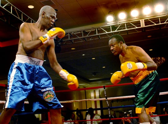 Willie Herenton, left, then Memphis mayor, goes a few rounds with former heavyweight champion Joe Frazier during their charity bout at the Peabody Hotel on Nov. 30, 2006. Herenton is running for mayor again.