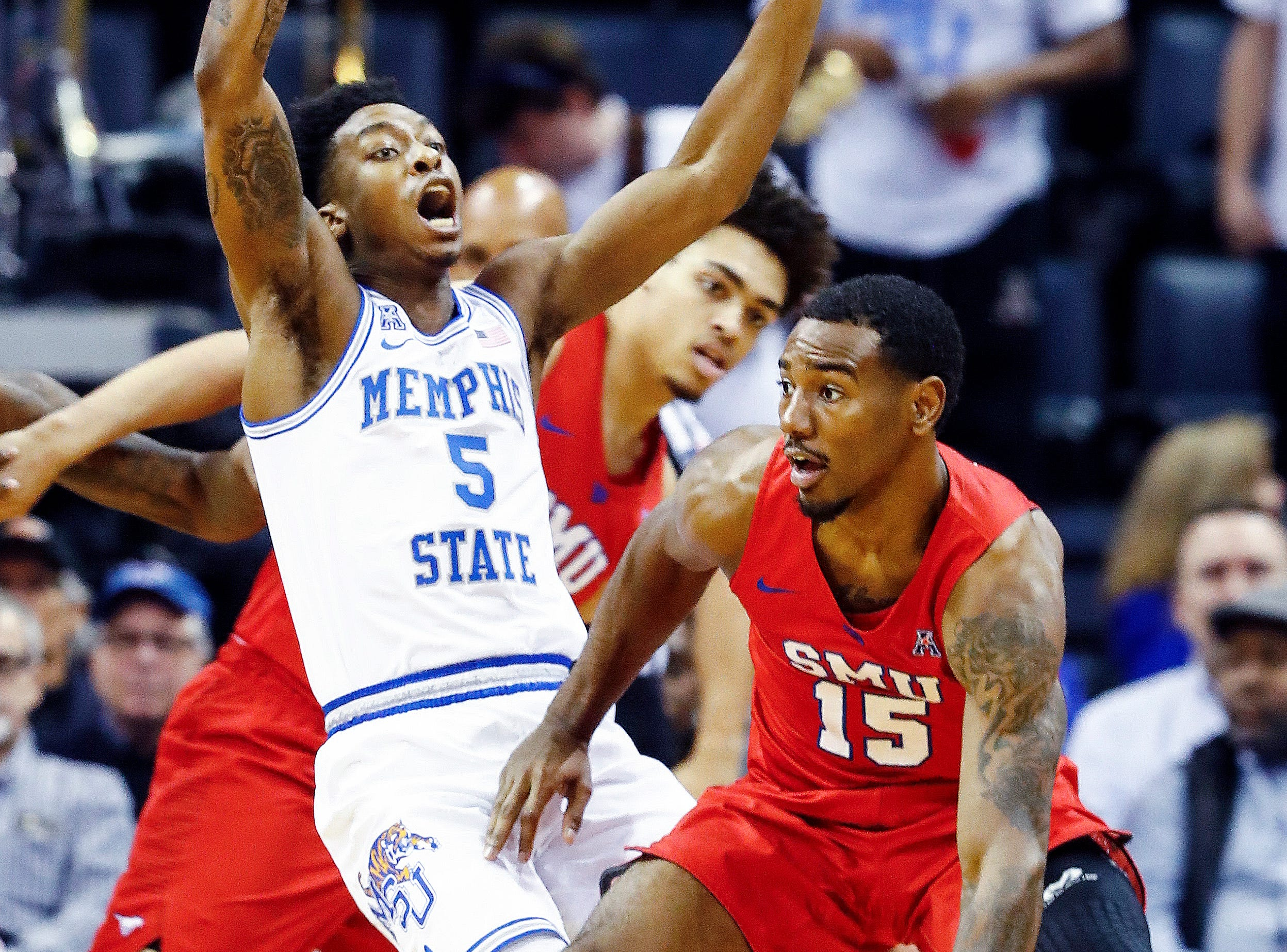 Memphis guard Kareem Brewton Jr. (left) applies defensive pressure to SMU guard Isiaha Mike (right) during action at the FedExForum, Saturday, January 19, 2019.