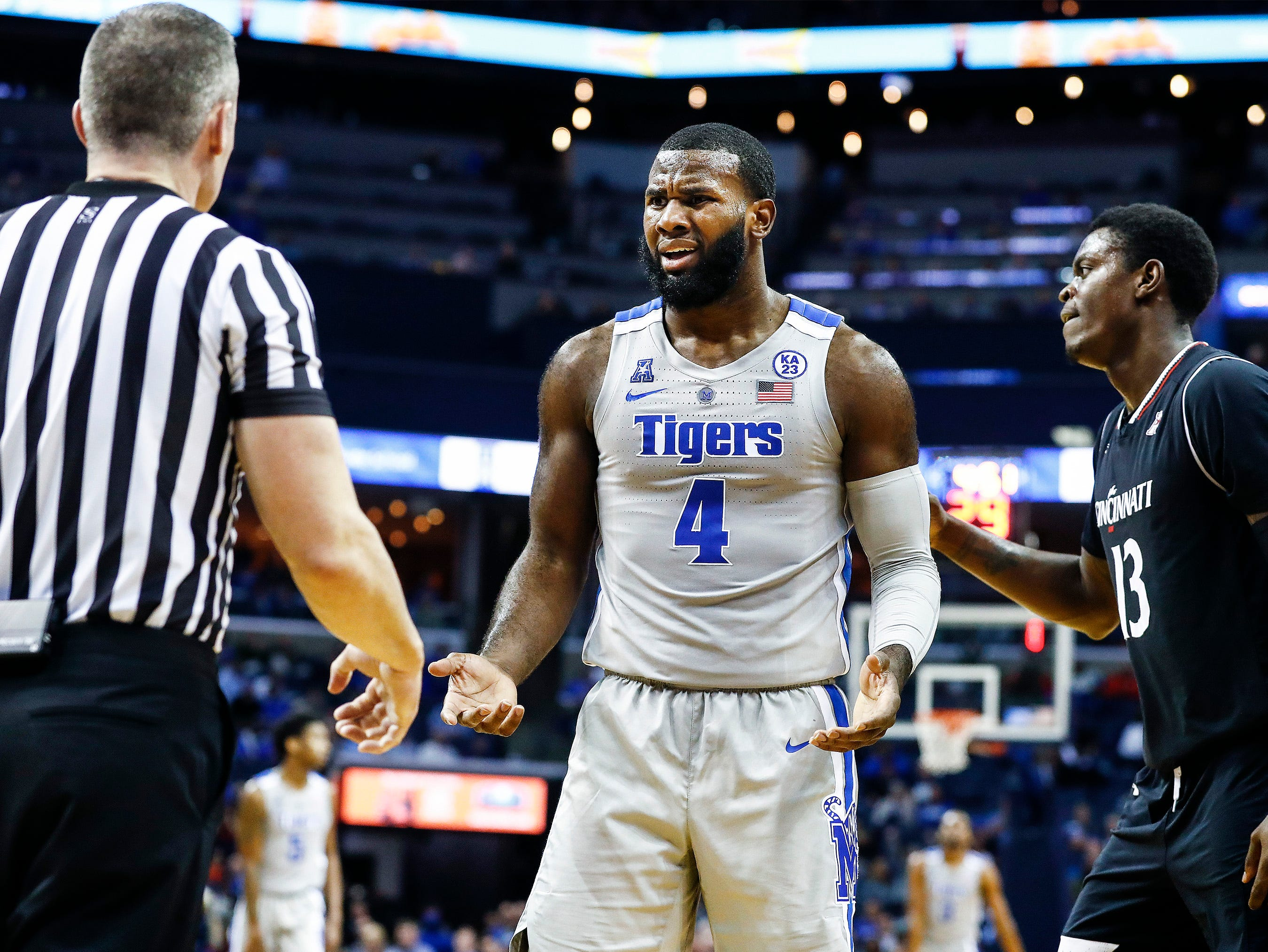 Memphis forward Raynere Thornton (middle) reacts after being called for a foul against Cincinnati during action at the FedExForum, Thursday, February 7, 2019.