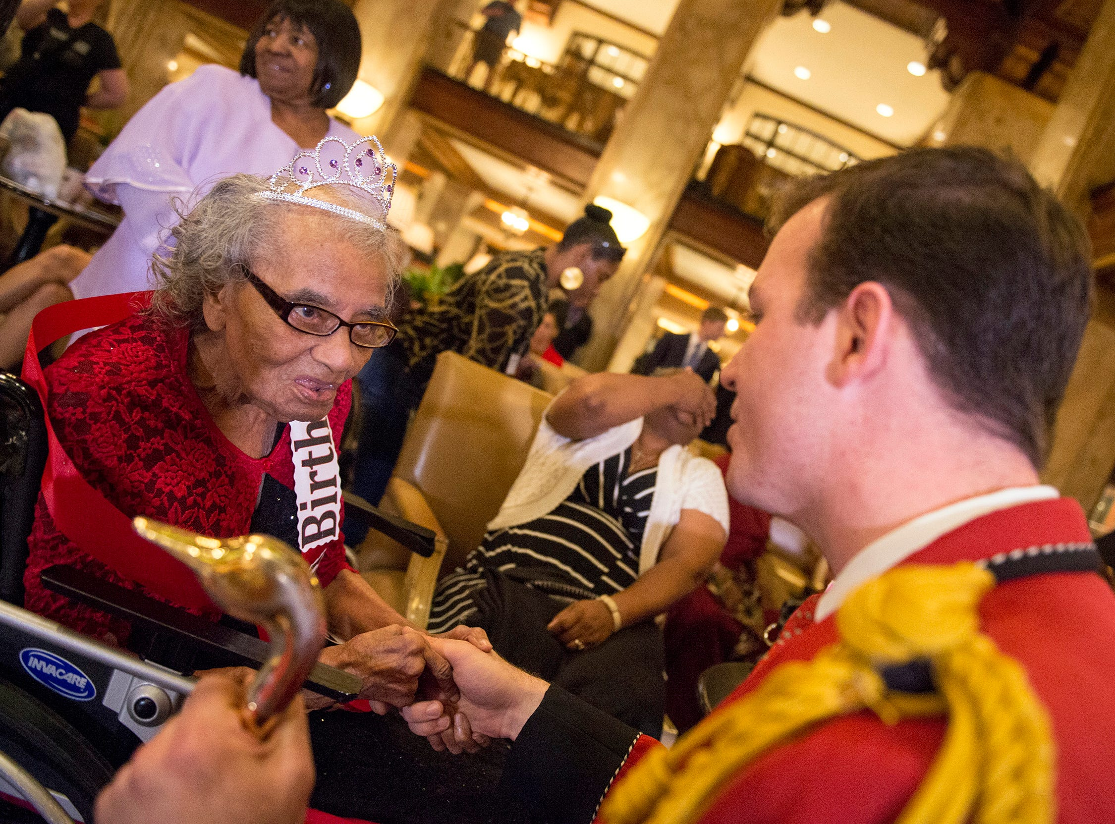 """Peabody Duckmaster Anthony Petrina, right, talks with Dorothy Davis as she celebrates her 105th birthday by serving as honorary duckmaster at the Peabody Hotel on April 29, 2016. Davis is a patient at Crossroads Hospice which arranged the event, a """"Gift of a Day"""" which they offer all their patients. Davis once worked at the Peabody Hotel as an elevator operator."""