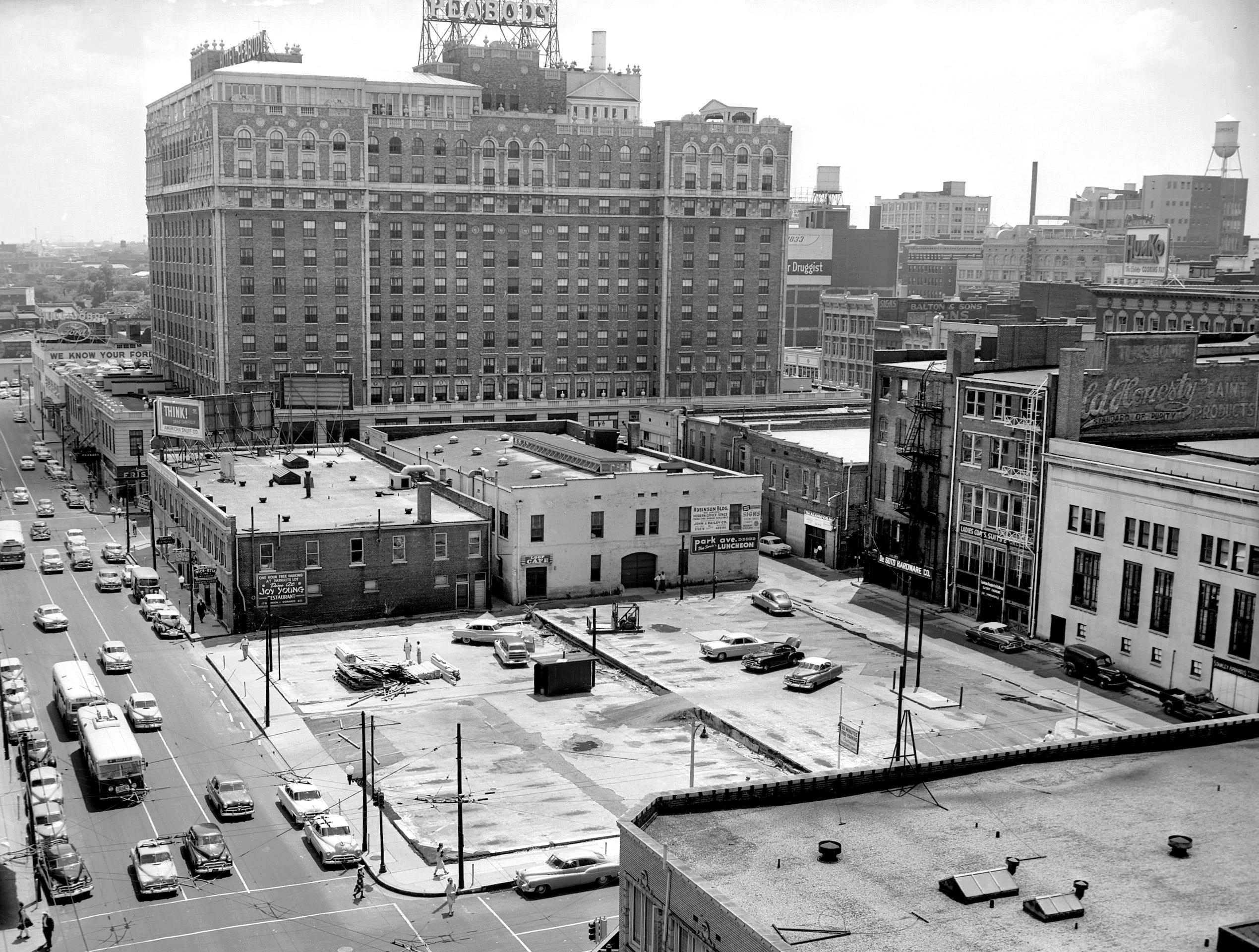 With the Peabody Hotel in the background, construction workers began clearing the parking lot at Third and Monroe June 14, 1954 where a 300-car parking garage for Parkrite, Inc. will be built.