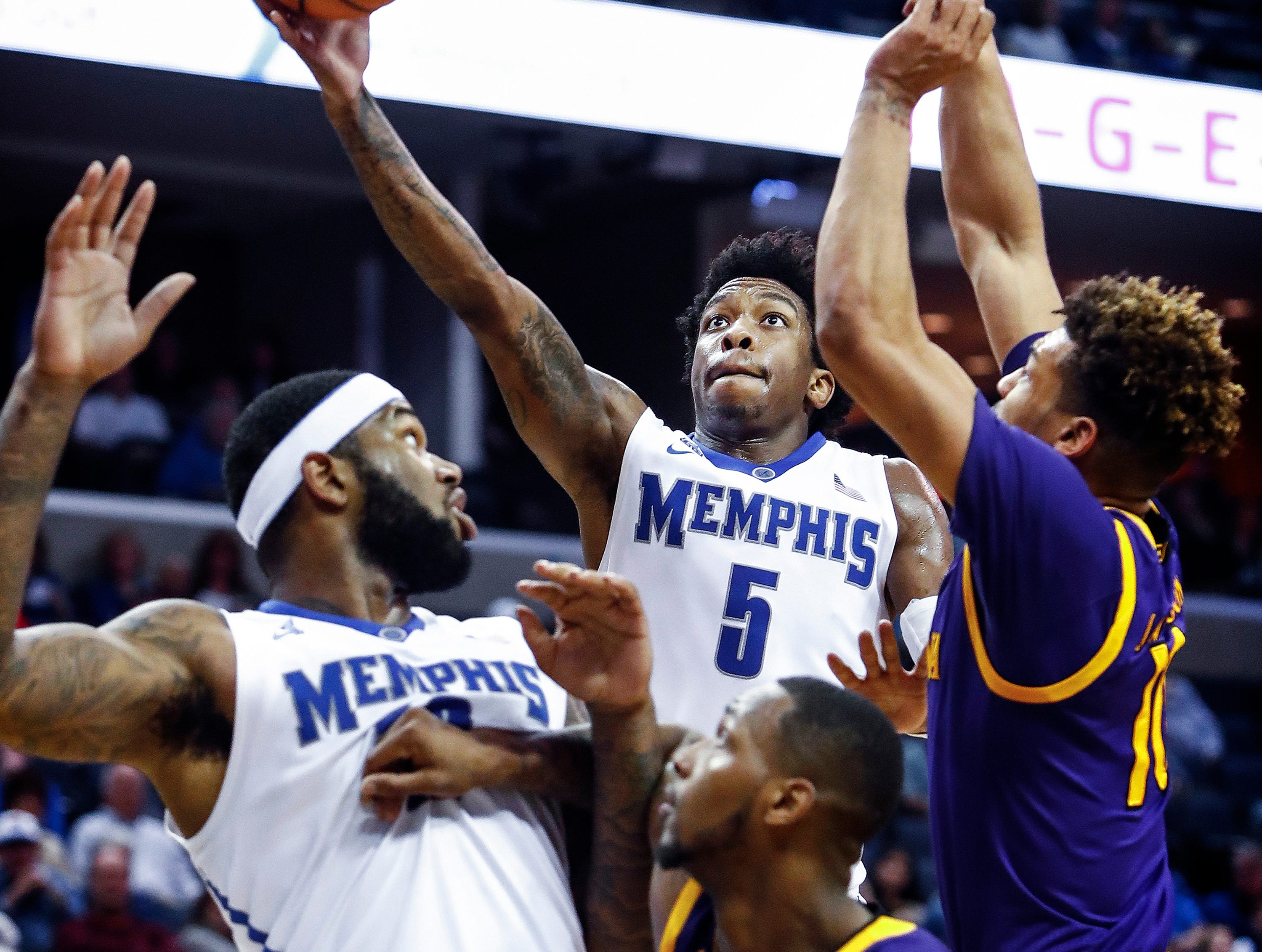 Memphis guard Kareem Brewton Jr. (top) drives for a layup against the ECU defense during second half action at the FedExForum in Memphis Tenn., Sunday, March 4, 2018.