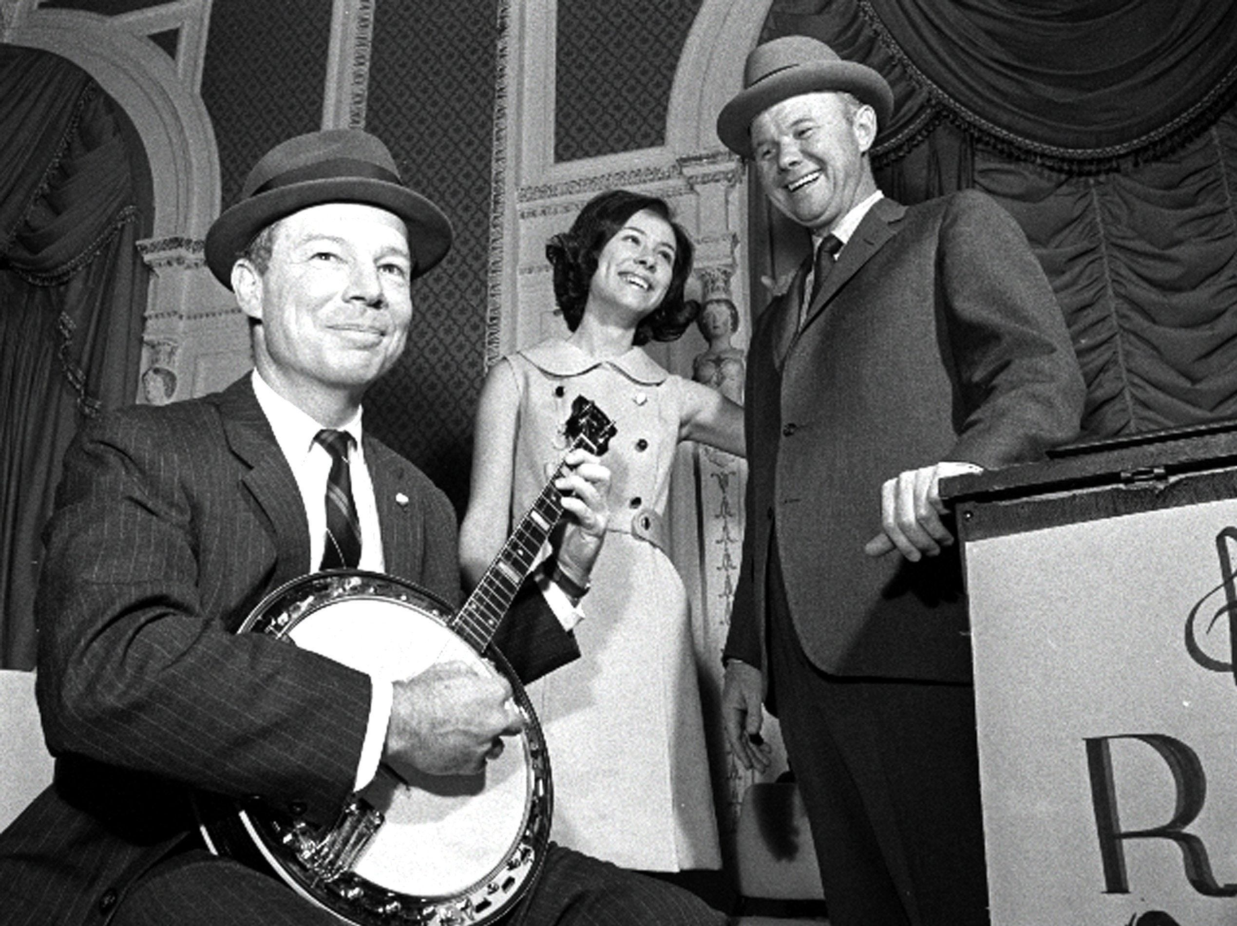 S. Toof Brown Jr., left, president of the Cotton Carnival Association, got the evening in tune at the Crown and Sceptre kickoff dinner at the Sheraton-Peabody on Jan 8, 1969. With him are Memphis Junior Miss Betty Ann Hunt and John Starks, co-chairman. The dinner marked the beginning of the carnival fund drive.