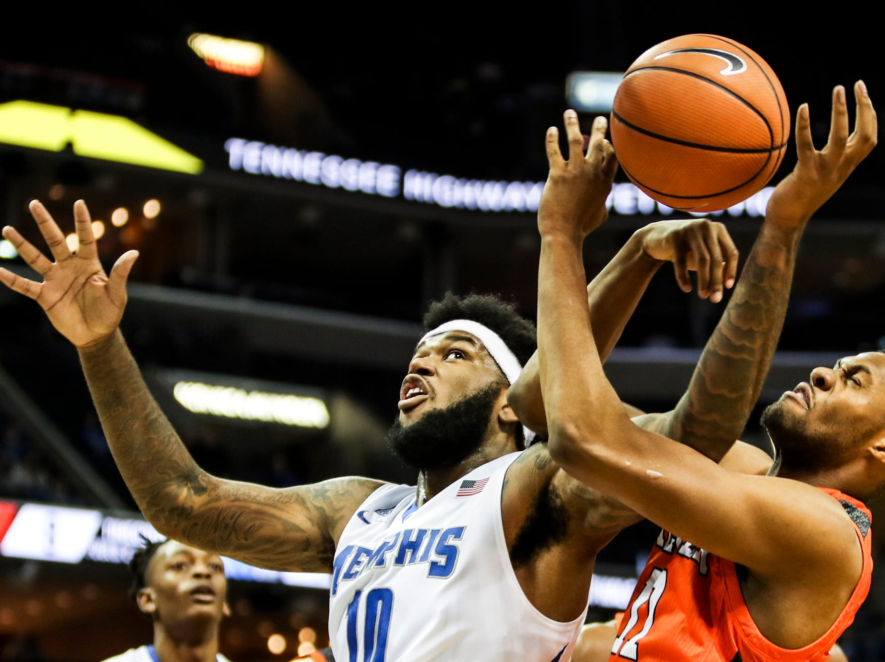 December 02, 2017 - Memphis' Mike Parks Jr. battles for a rebound against Mercer's Ryan Johnson during Saturday's game at the FedExForum.