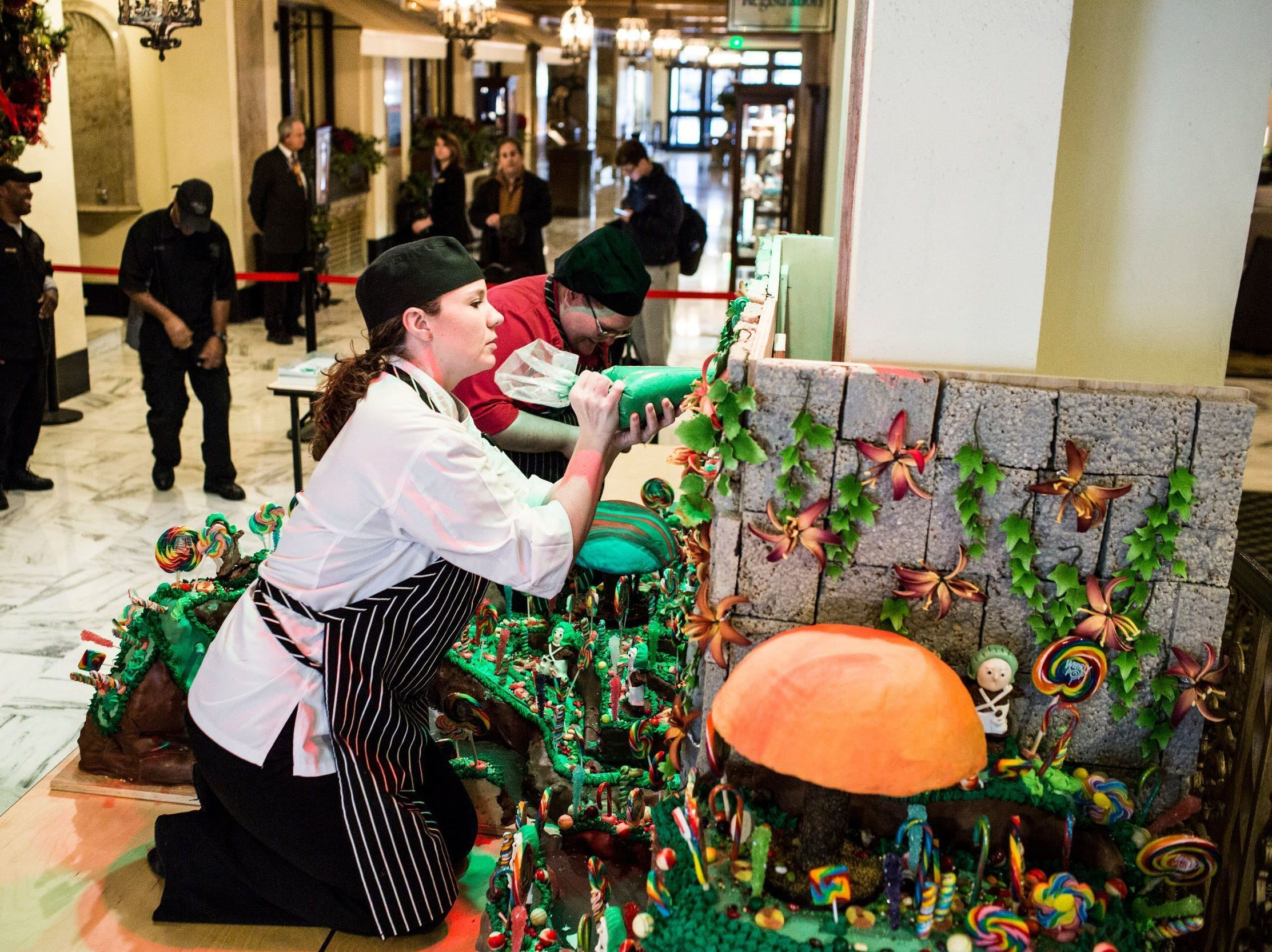 Elaine Jones, assistant executive pastry chef, adds frosting to the holiday gingerbread display at the Peabody Hotel on Nov. 20, 2018. Executive pastry chef Konrad Spitzbart does an elaborate holiday gingerbread display every year.