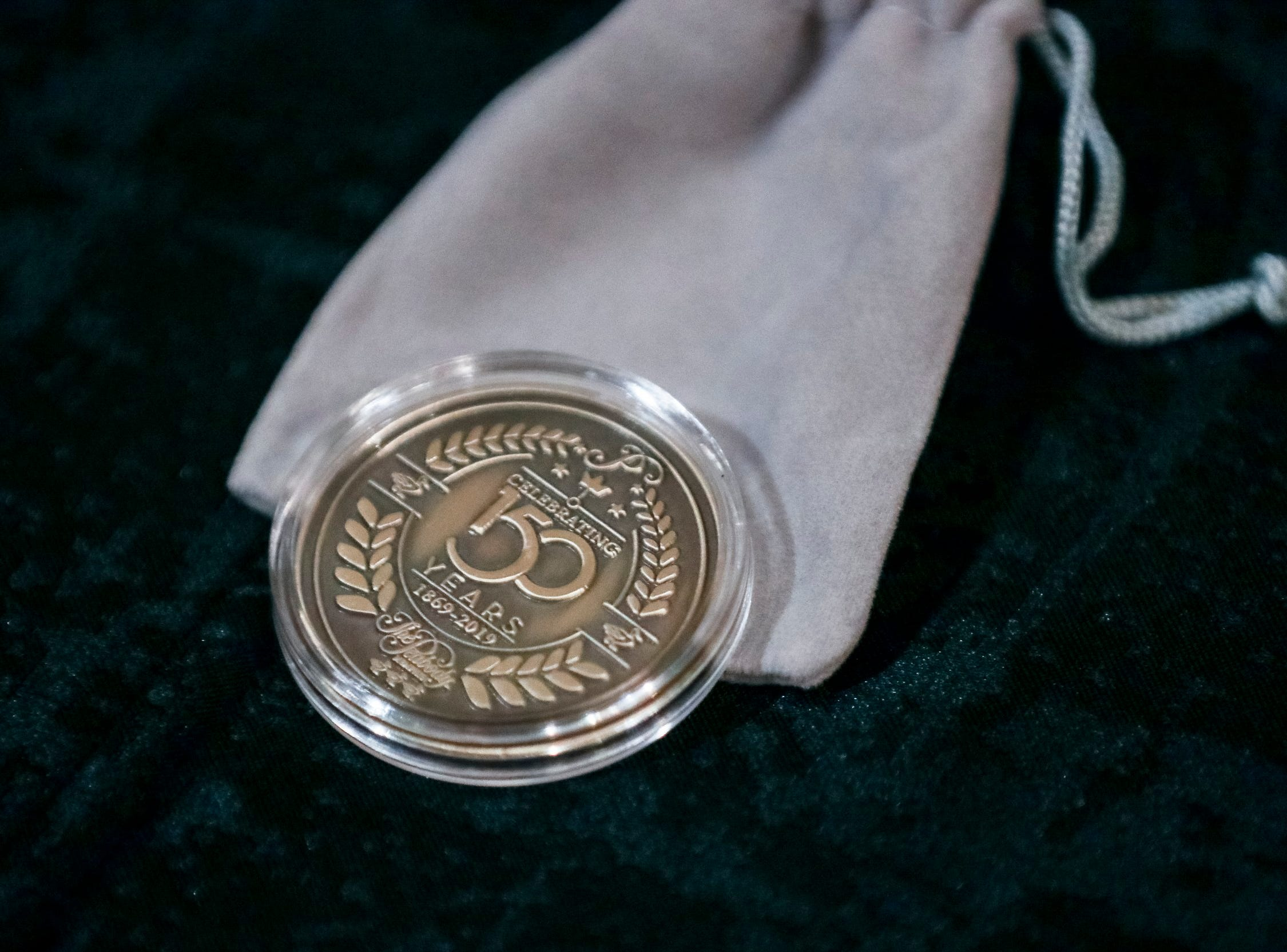 A Peabody 150th Anniversary commemorative coin is seen during The Peabody 150th anniversary media launch party Feb. 6, 2019.