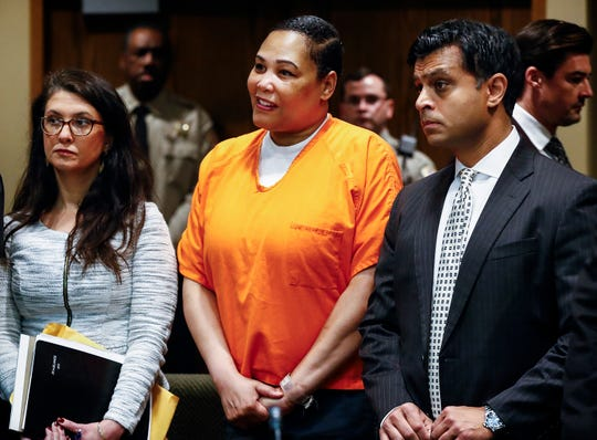 Sherra Wright, center, stands in court with her attorneys Laurie Hall, left, and Juni Ganguli during an appearance in Judge Lee Coffee's courtroom Friday morning. Wright and co-defendant Billy Turner are charged in the killing of former NBA player Lorenzen Wright.