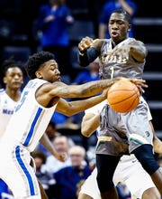 Memphis defender Kareem Brewton Jr. (left) steals the ball away from UAB gaurd Zack Bryant (right) during action at the FedExFourm in Memphis, Tenn., Saturday December 8, 2018