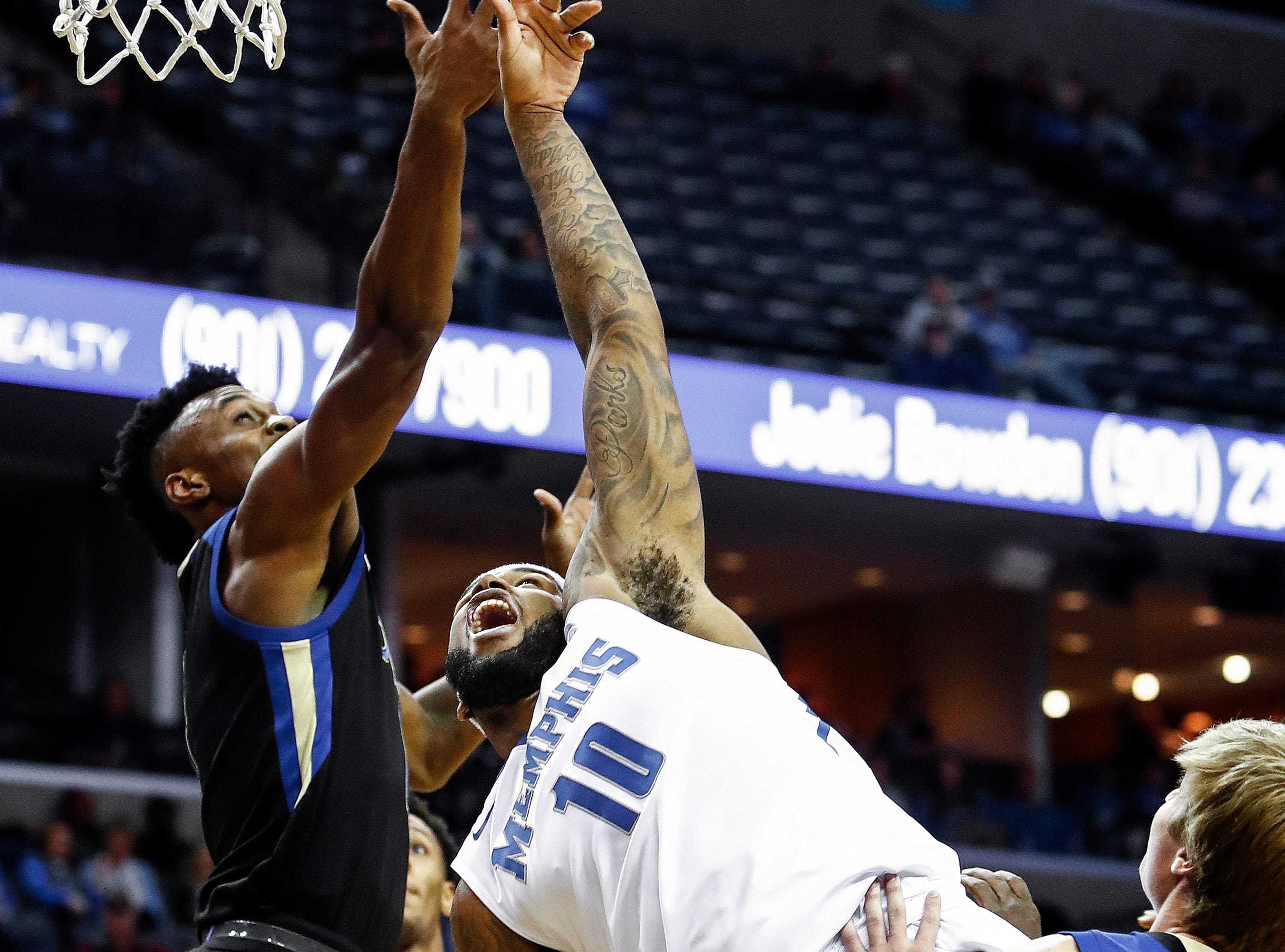 Memphis forward Mike Parks Jr., (right) battles the Tulsa defense for a rebound during first half action at the FedExForum in Memphis Tenn., Saturday, January 6, 2017. Parks had career-high 16 points during the 76-67 victory over Tulsa.
