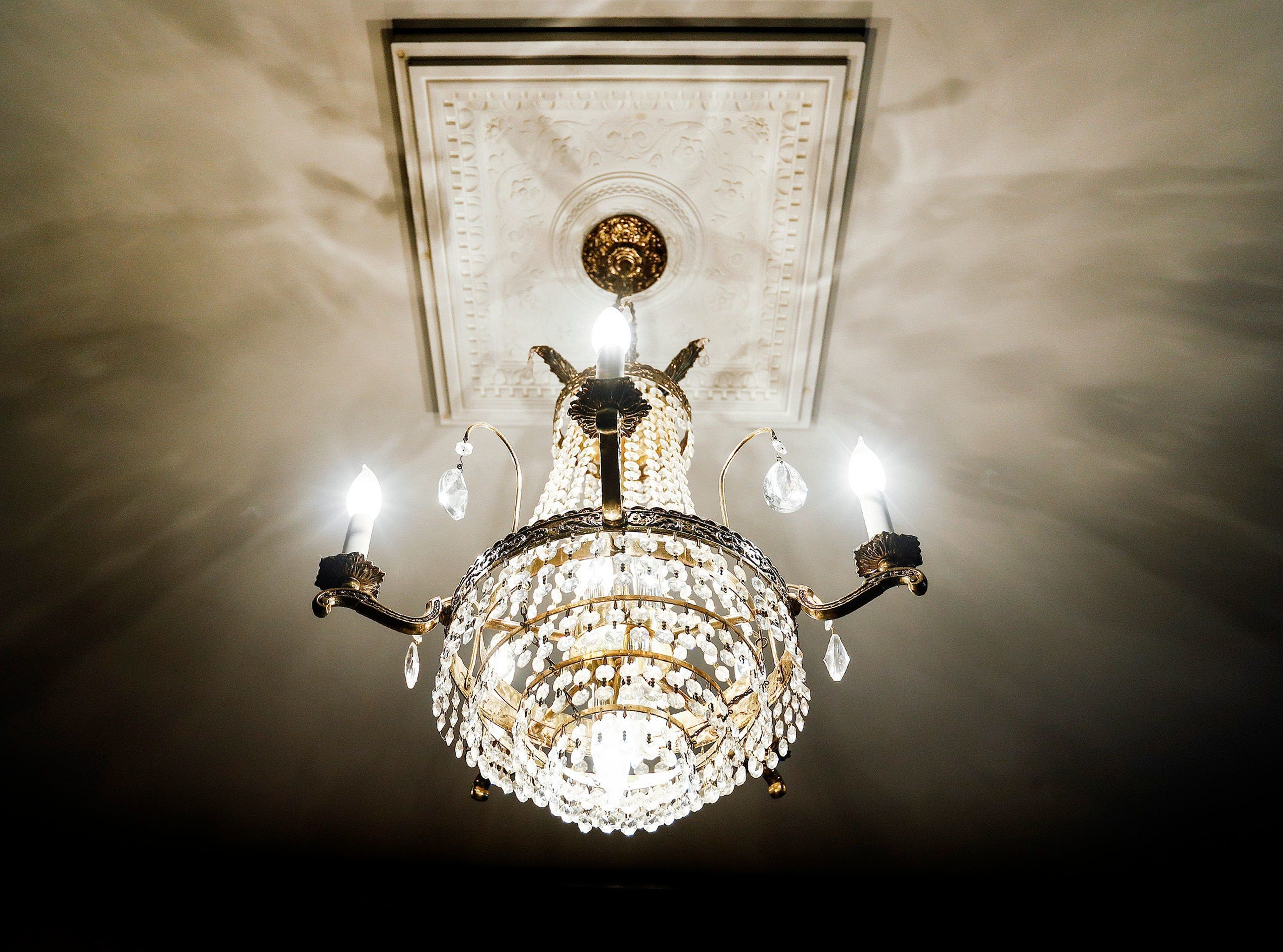 The house at 1716 North Parkway, which was built in 1906 has several chandeliers, like this one on April 29, 2018, that once lived in the downtown Peabody Hotel.
