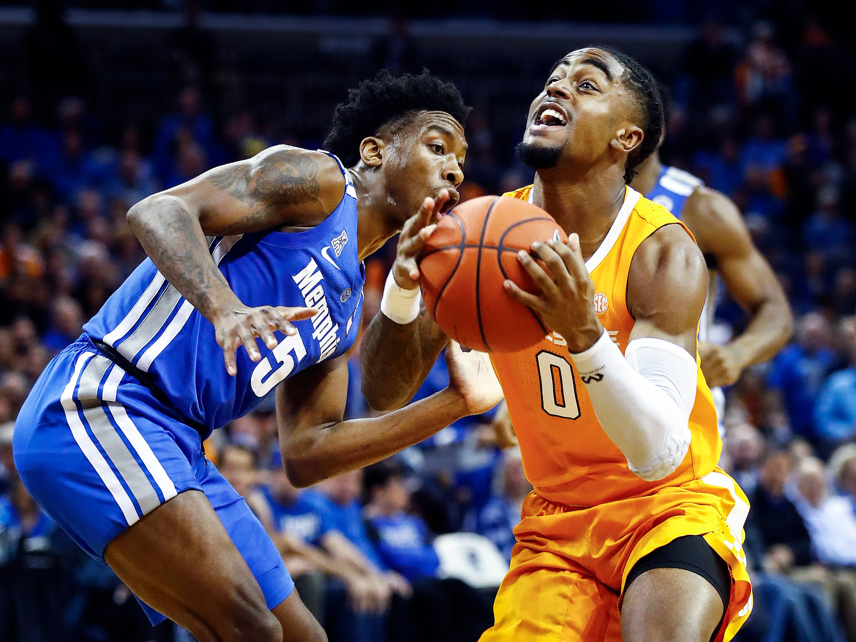 Tennessee guard Jordan Bone (right) drives by Memphis defender Kareem Brewton Jr. (left) during action at the FedExForum, Saturday, December 15, 2018.