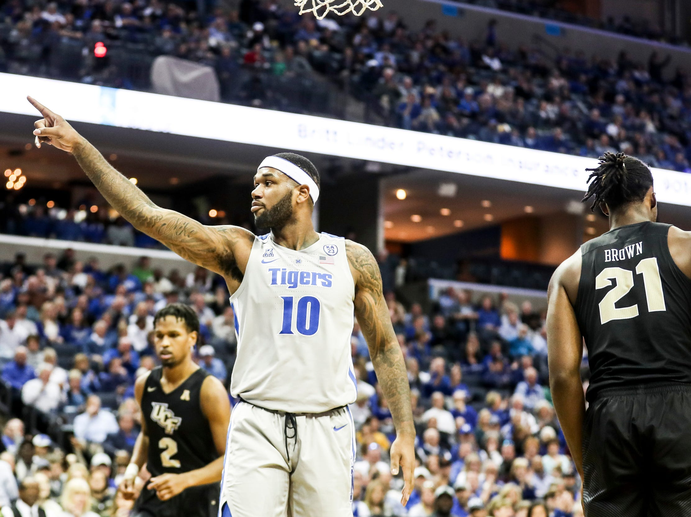 January 27 2019 - Mike Parks Jr. points out to fans during Sunday afternoon's game against UCF at the FedExForum in Memphis.