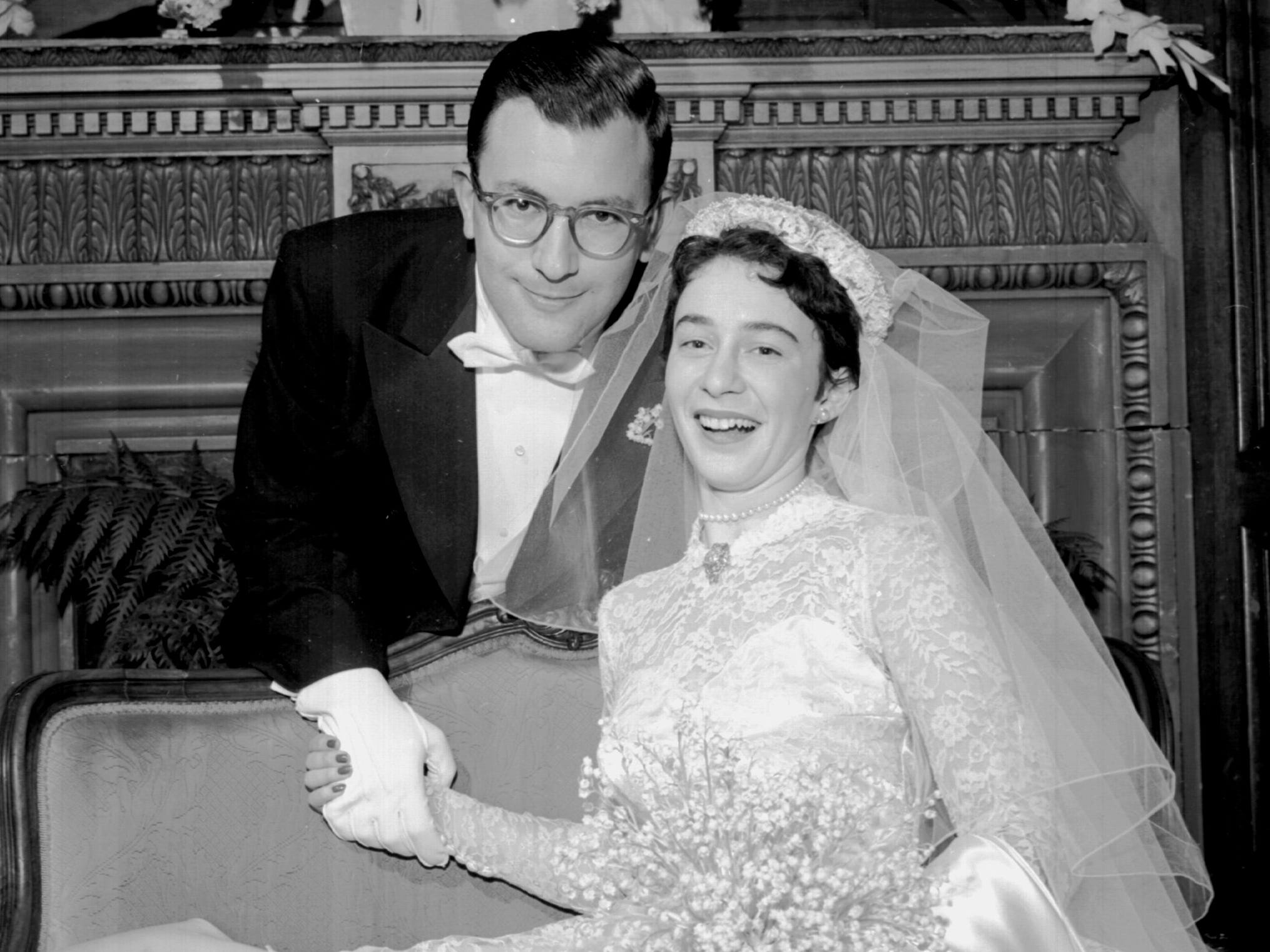 """Mr. and Mrs. Rudi Egon Scheidt pause in festivities at the Peabody following their wedding Feb. 13, 1954. She is the former Miss Helen """"Honey"""" Hohenberg, daughter of Mrs. and Mrs. Adolph Elkan Hohenberg of 54 White Station Road."""