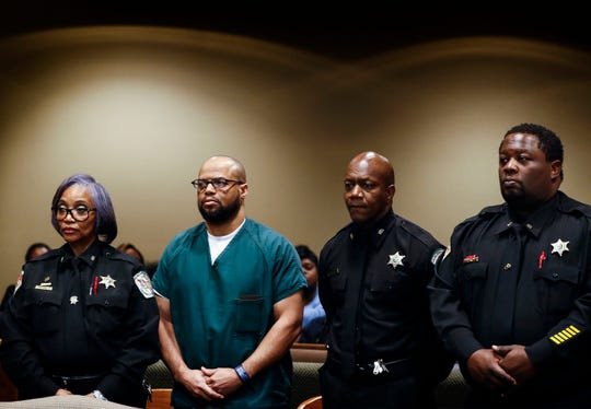 Surrounded by officers of the court defendant Billy Ray Turner (second left) makes an appearance in Judge Lee Coffee courtroom Friday morning. Billy Ray Turner and co-defendant Sherra Wright, are charged in the killing of former NBA player Lorenzen Wright.