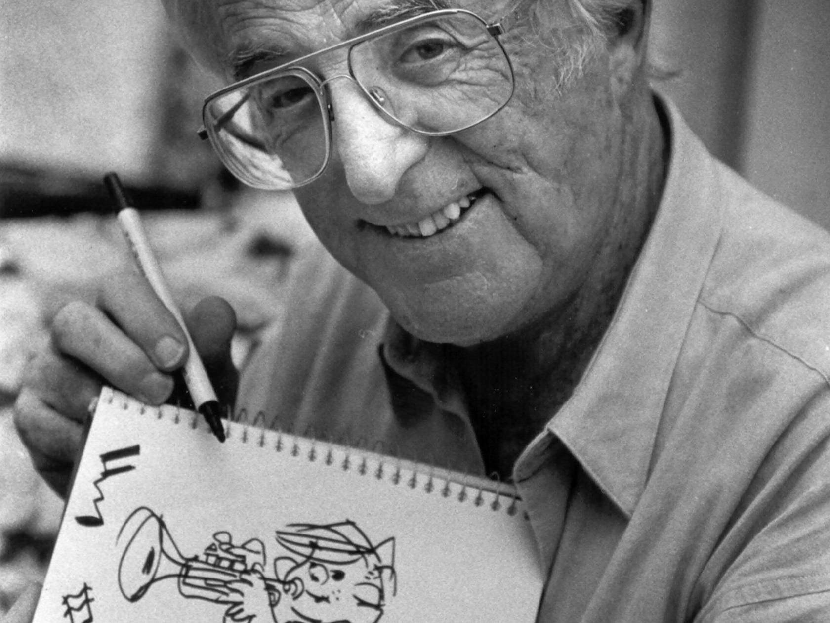 Cartoonist Hank Ketcham and his creation, Dennis the Menace, make a statement about Memphis and its music heritage during a visit at The Peabody Hotel on Oct. 28, 1991.