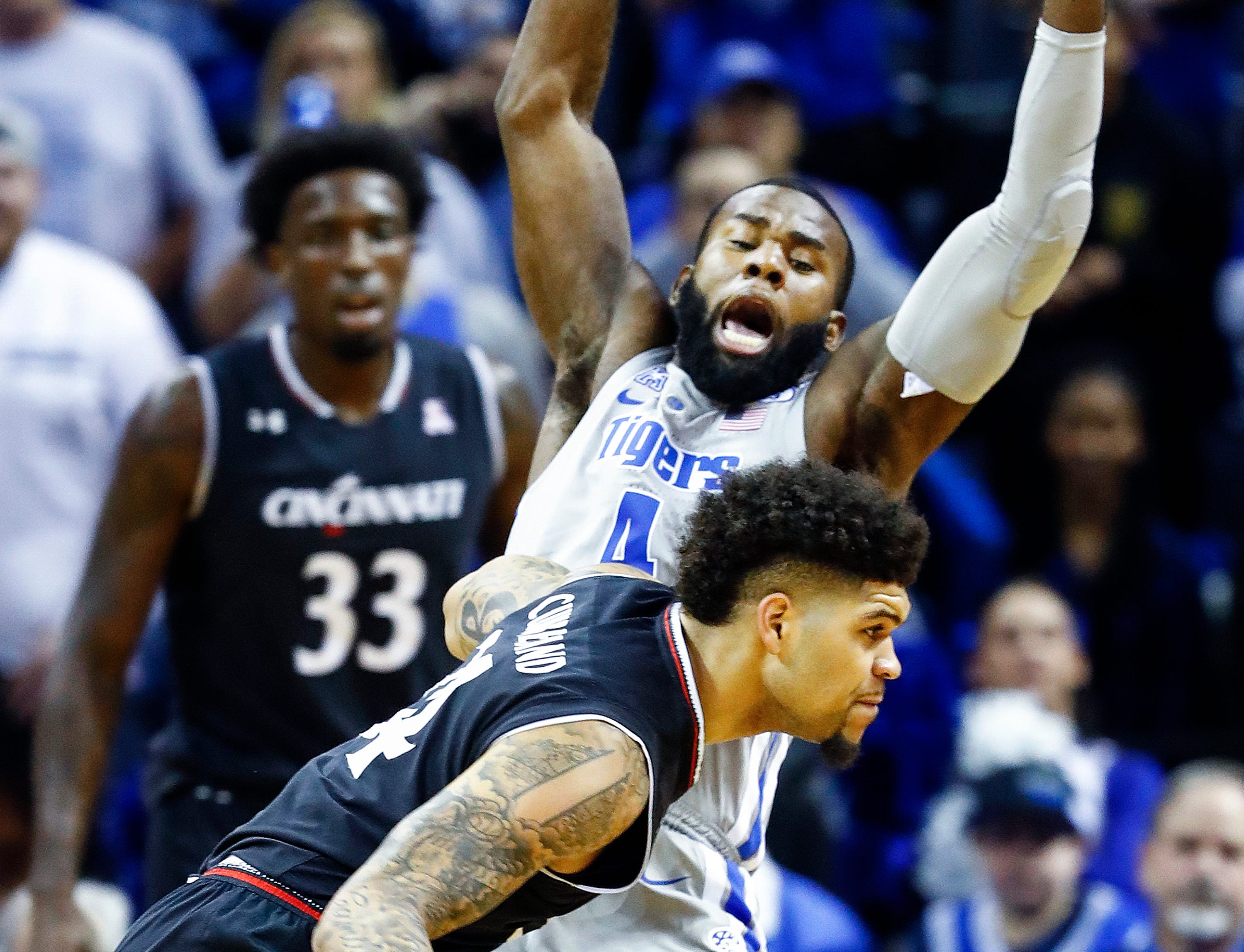 Memphis defender Raynere Thornton (back) applies defensive pressure to Cincinnati guard Jarron Cumberland (front) during action at the FedExForum, Thursday, February 7, 2019.
