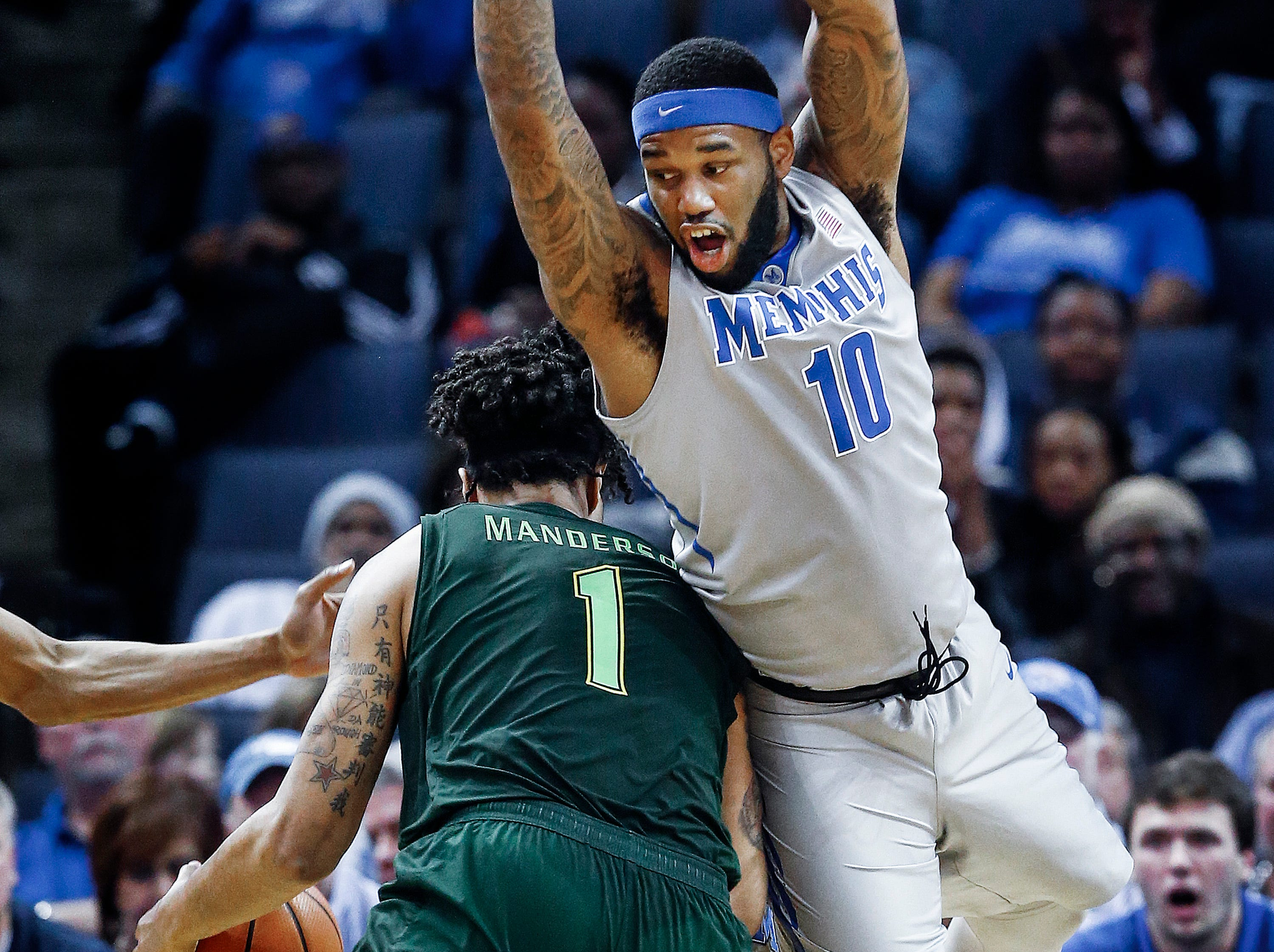 Memphis defender Mike Parks Jr. (right) fouls USF forward Isaiah Manderson (left) during second half action at the FedExForum in Memphis Tenn., Thursday, March 1, 2018.
