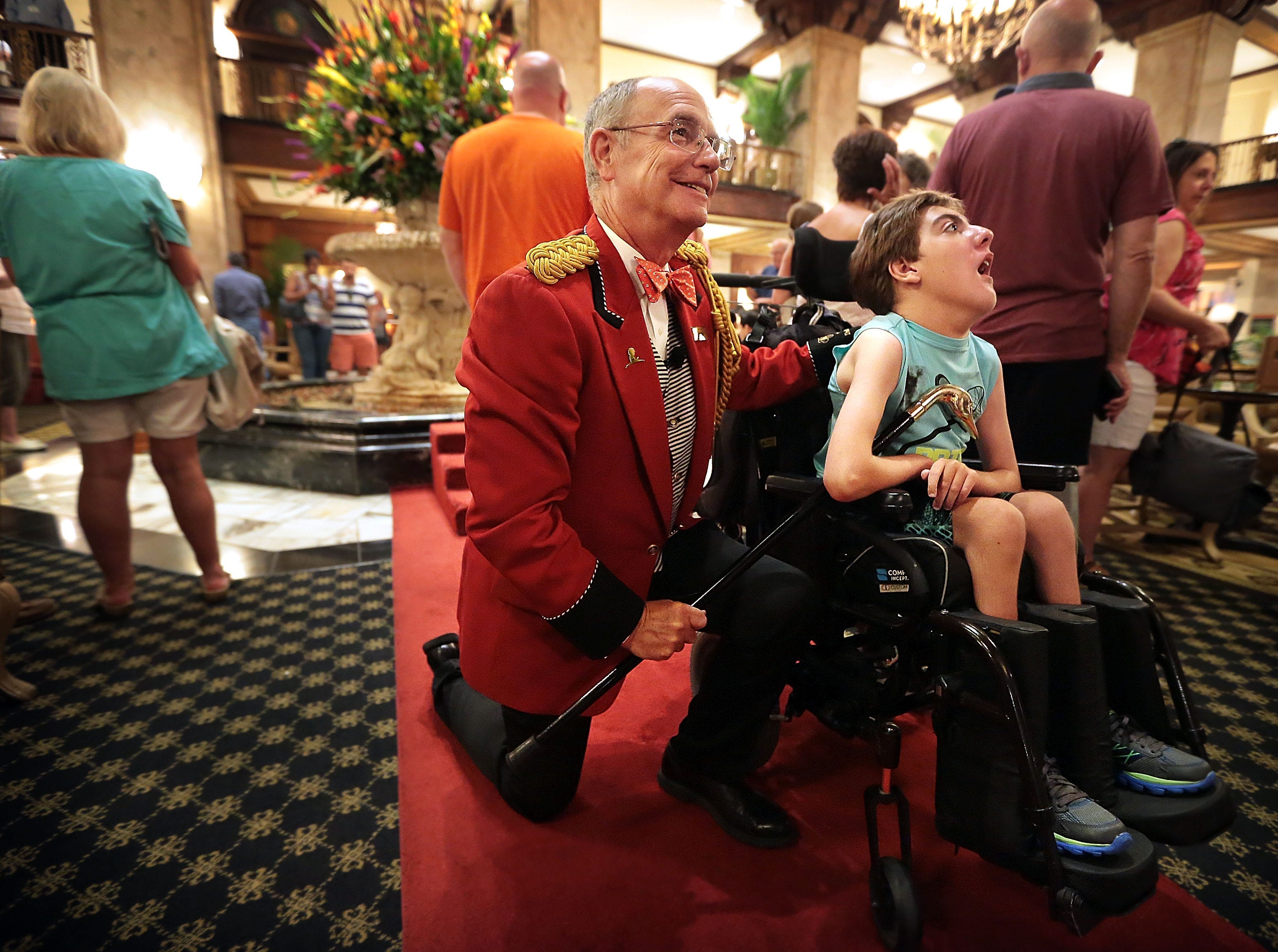 Shelby County Historian Jimmy Ogle, left, poses for a picture with Todd Brayman of Penaukee, Wis., during his first day on the job as the Peabody duckmaster Sept. 21, 2016. Ogle is the hotel's 6th official duckmaster replacing Anthony Petrina who held the post for five years.