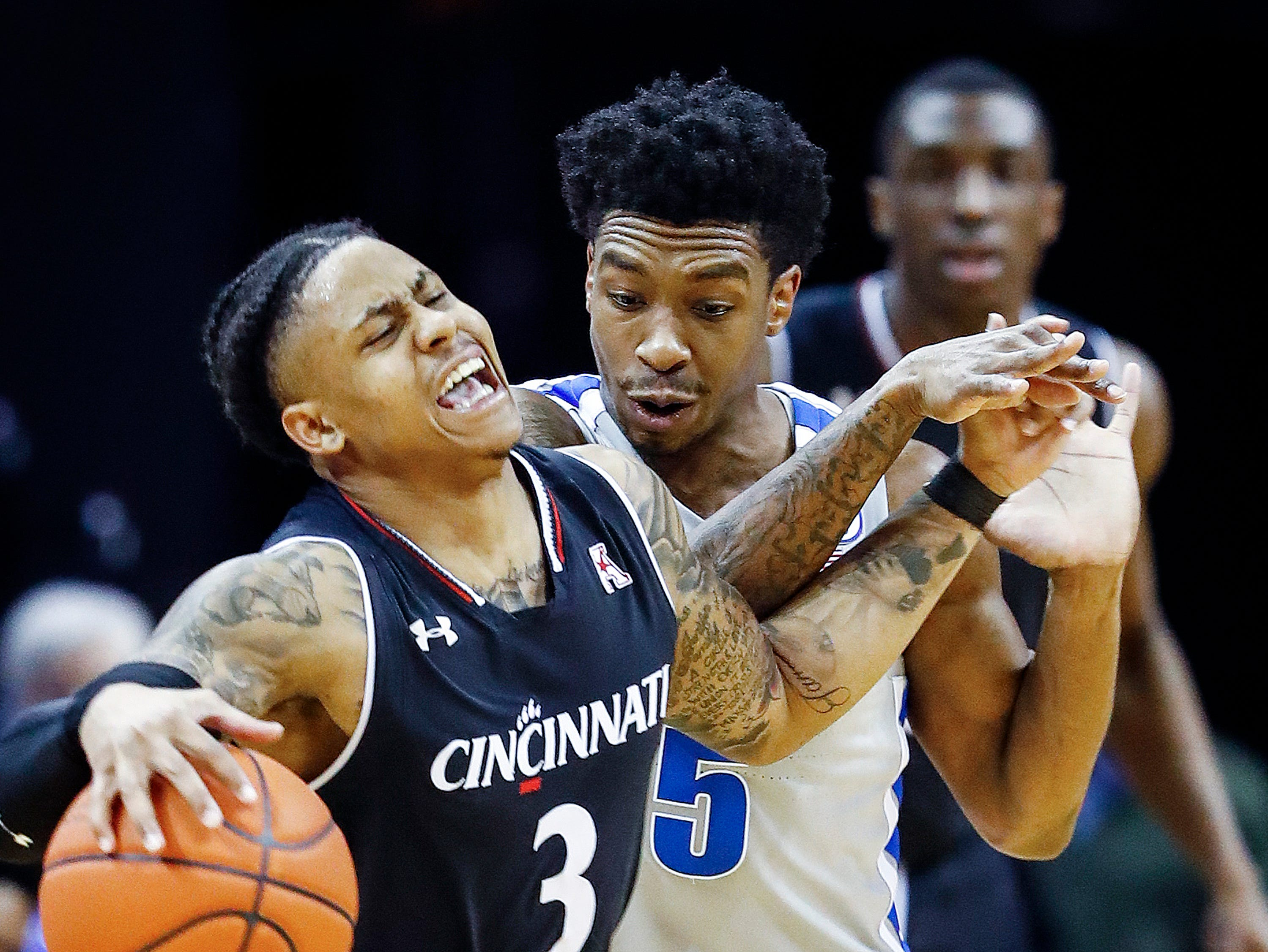 Memphis defender Kareem Brewton Jr. (right) guards Cincinnati guard Justin Jenifer (left) during action at the FedExForum, Thursday, February 7, 2019.