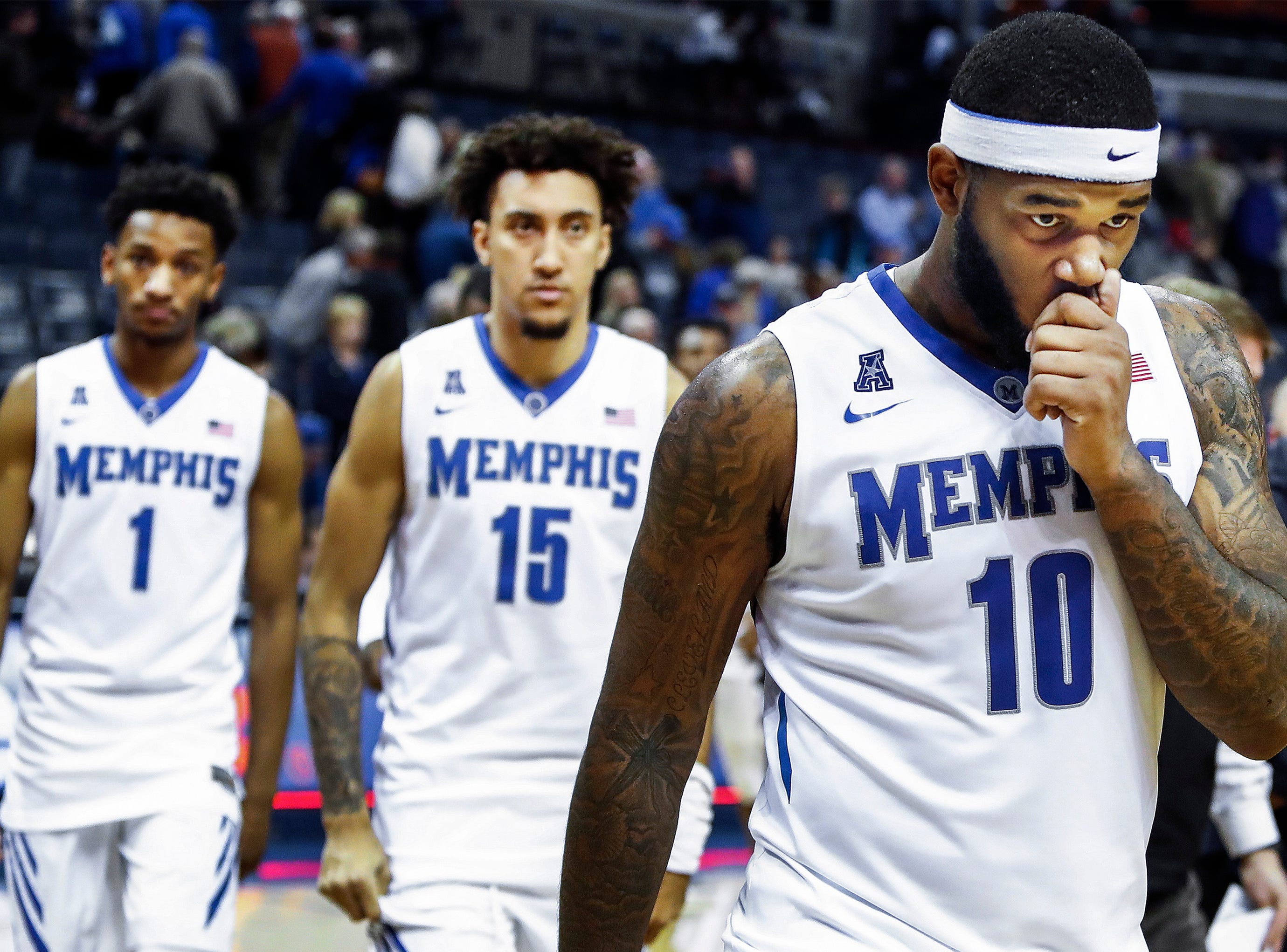 Memphis forward Mike Parks Jr. walks off the court after the Tigers loss to Cincinnati 62-48 at the FedExForum in Memphis Tenn., Saturday, January 27, 2018.
