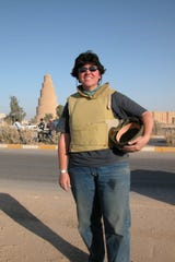 Milwaukee Journal Sentinel reporter Meg Jones stands outside the minaret of an 8th century mosque in Samarra, Iraq. in June 2005.