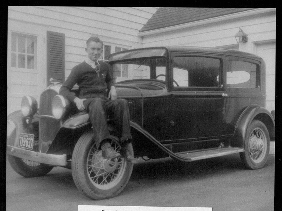 A photo of Jack Koepp with his first automobile. I twas a  1932 Plymouth.