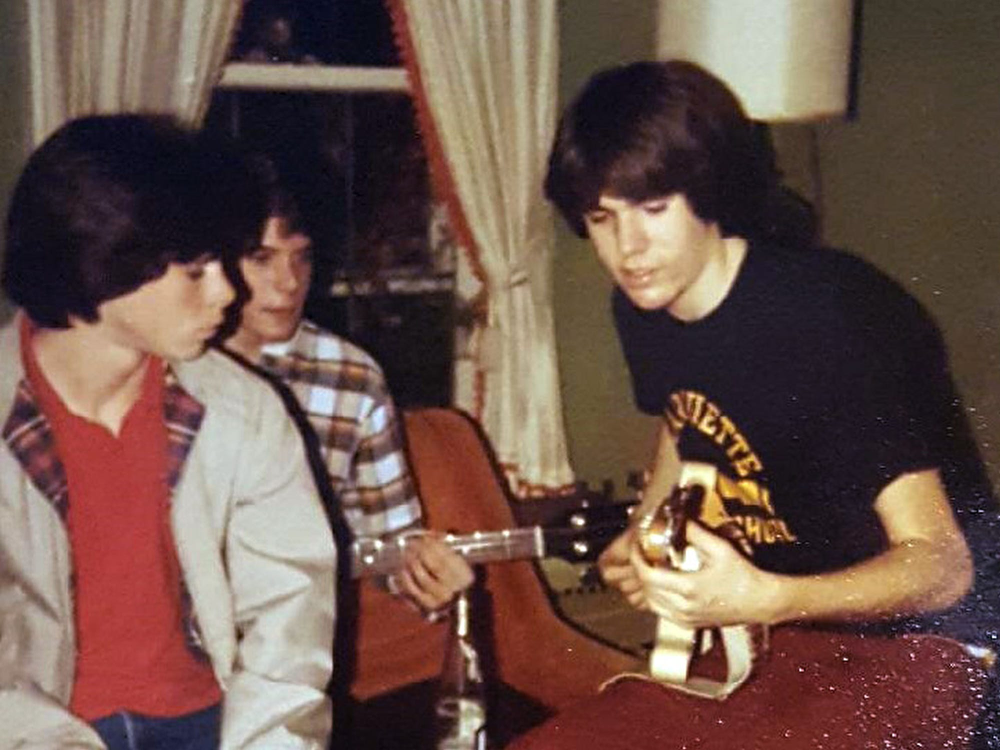 Well-known guitarist Greg Koch plays at one of the many parties at the O'Neill house, this one in 1983. He was invited to return Saturday to play again at a farewell party for the house.