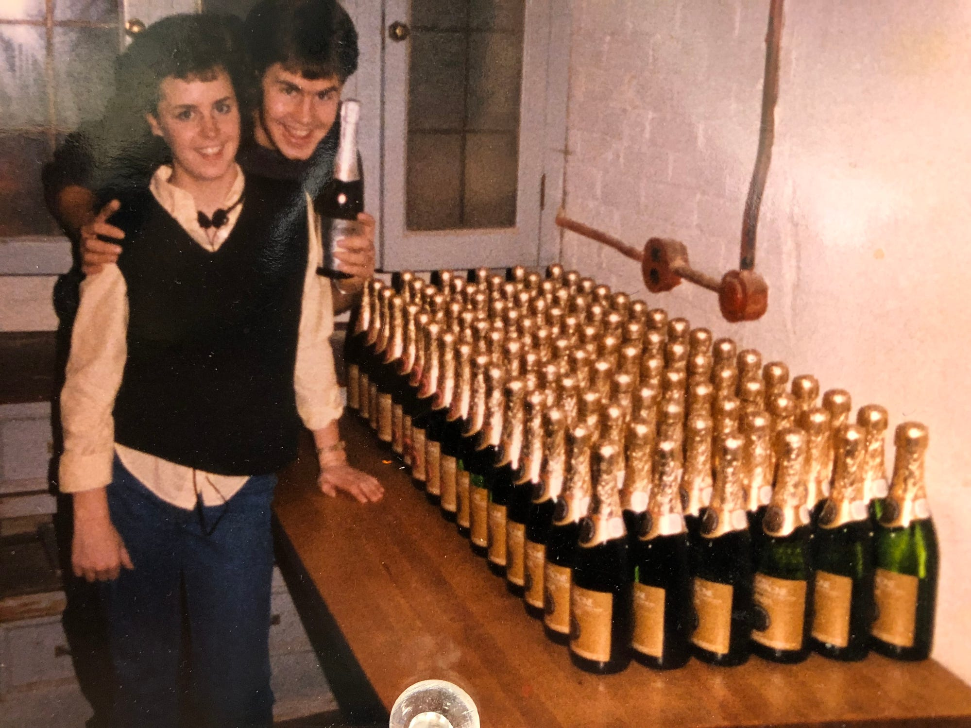 Nearly 100 bottles of champagne stood ready for a New Year's Eve party in 1984 run by Jen O'Neill and her brother, Matt, shown here.