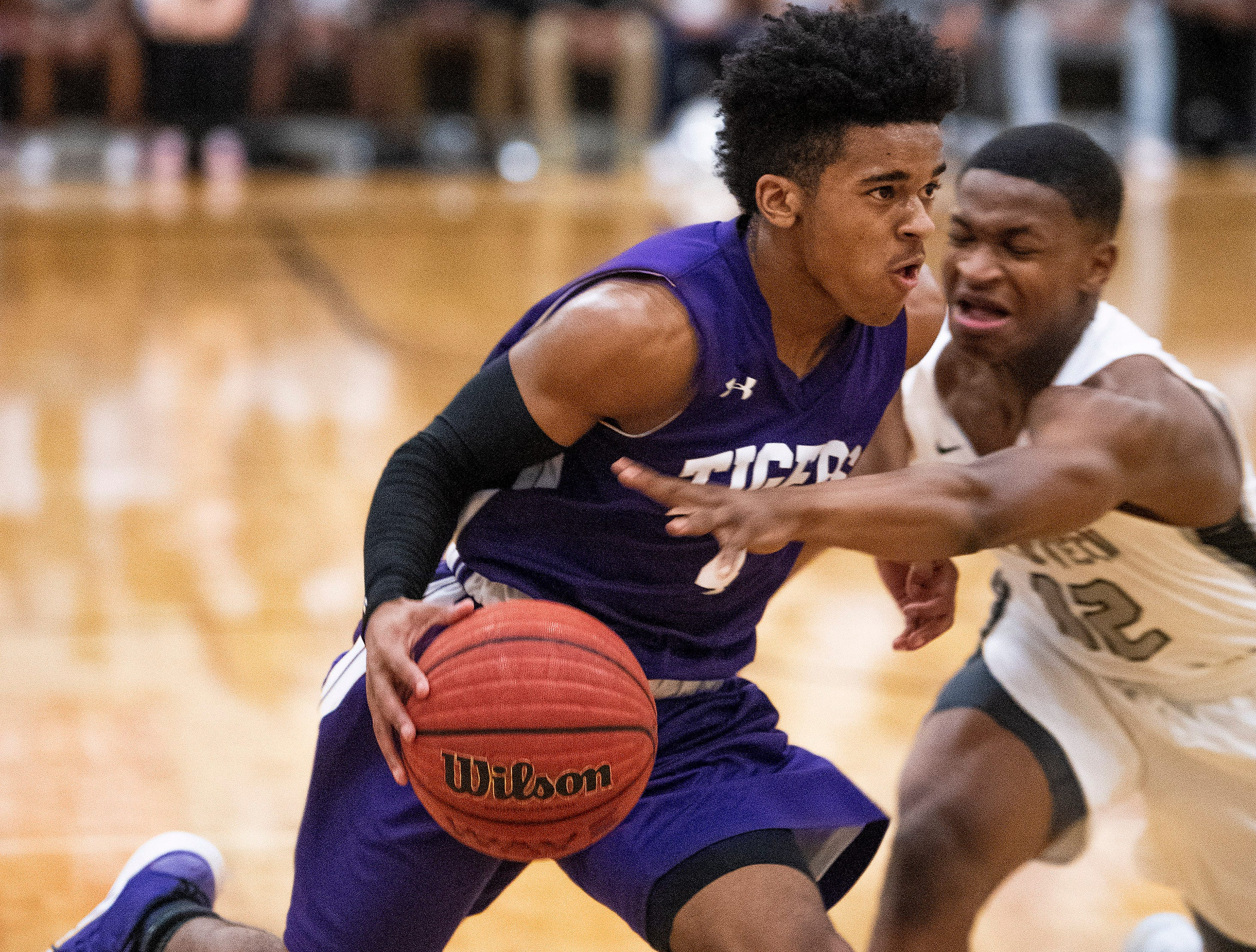 Brewbaker Tech's Mike Davis, Jr., (12) defends against Tallassee's Jamicah Humphery (4)at the BrewTech campus in Montgomery, Ala., on Thursday February 7, 2019.