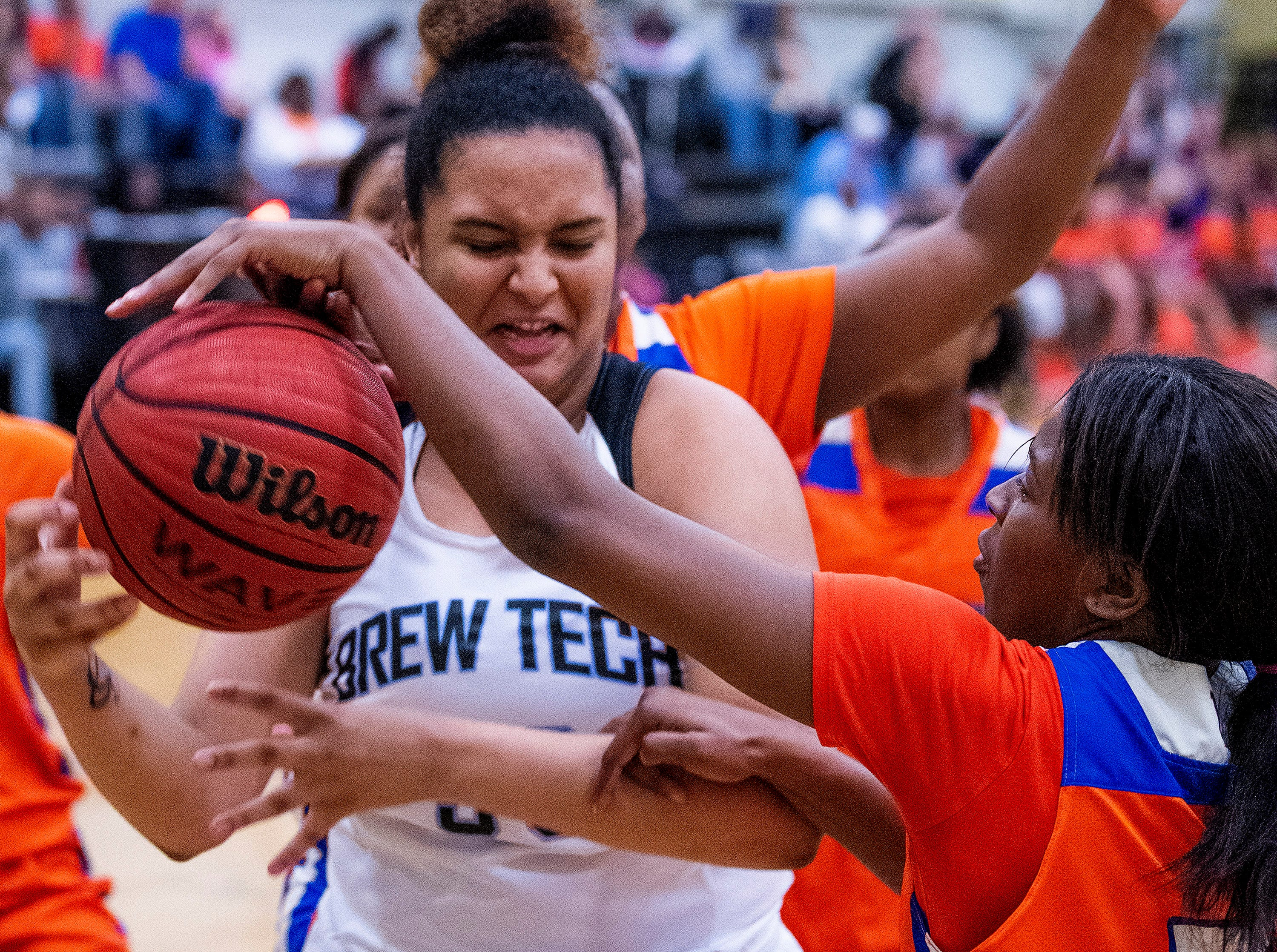 Brewbaker Tech's Jurnee Webster (30) and Valley's Chaquesda Florence (5) fight for the ball at the BrewTech campus in Montgomery, Ala., on Thursday February 7, 2019.
