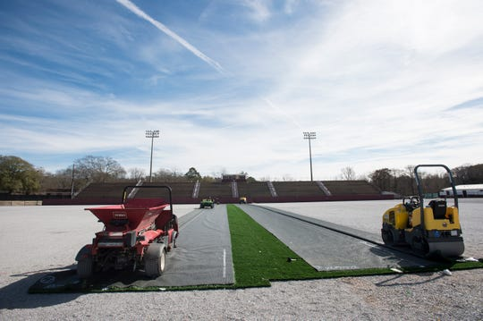 Crews work on replacing the turf field at Stanley Jensen Stadium in Prattville, Ala., on Friday, Feb. 8, 2019.