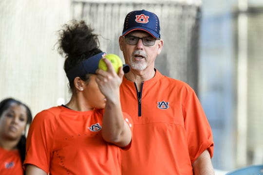 Auburn coach Mickey Dean works with pitcher Chardonnay Harris during practice.