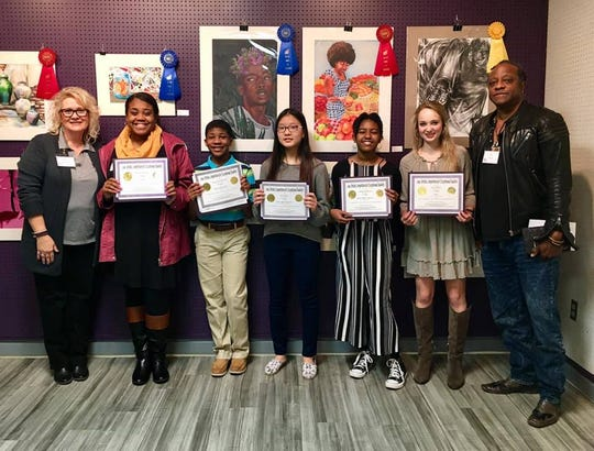 First place winners of the Artistic Competition for Exceptional Students pose with Danae Morgan, executive director of the Arts Council of Montgomery, and Bill Ford, president of the Arts Council of Montgomery.
