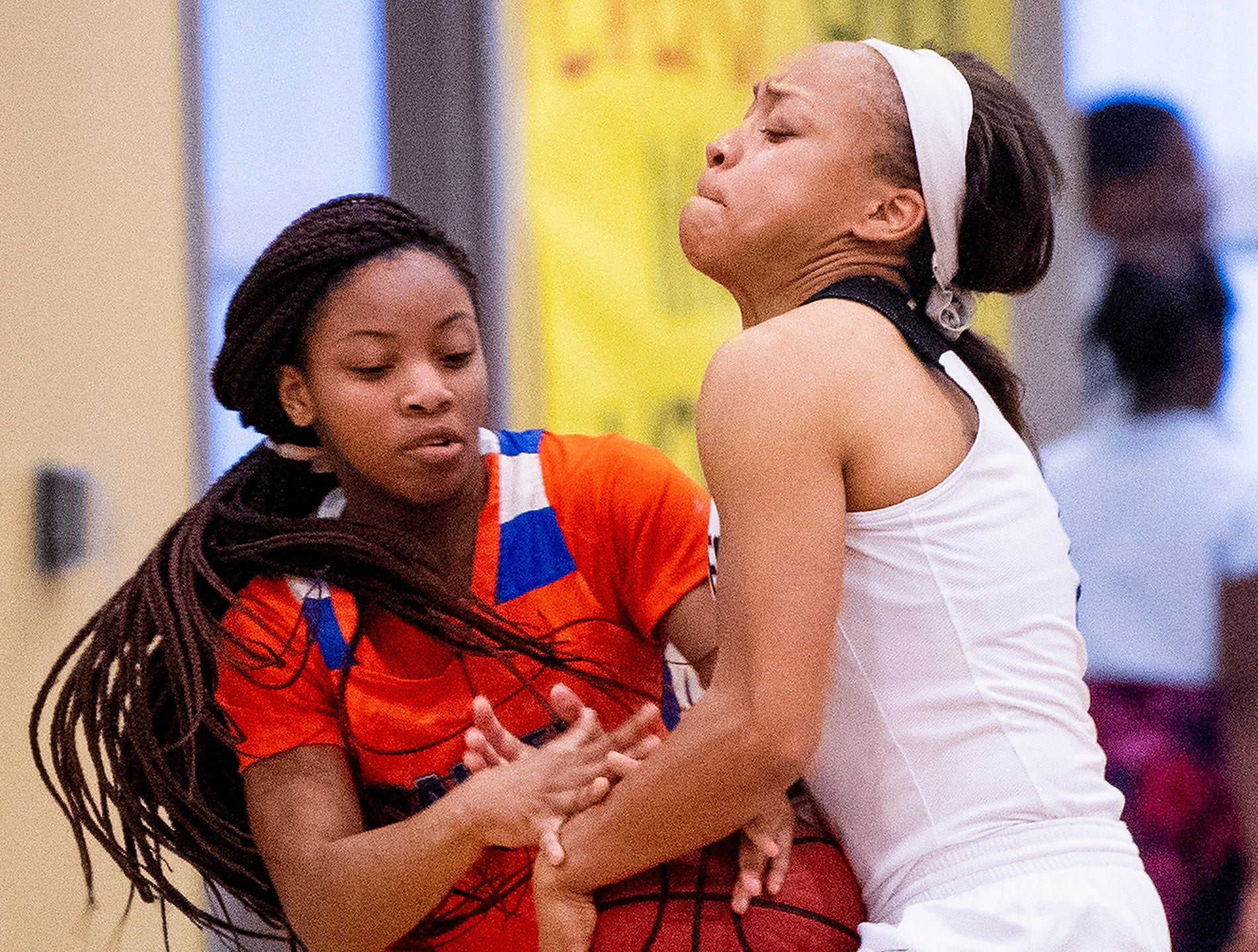 Valley's Jayla Lancaster (2), left, and Brewbaker Tech's Taylor Sharpe (1) fight for the ball at the BrewTech campus in Montgomery, Ala., on Thursday February 7, 2019.