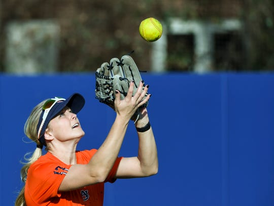 Auburn outfielder Morgan Podany catches a fly ball during practice.