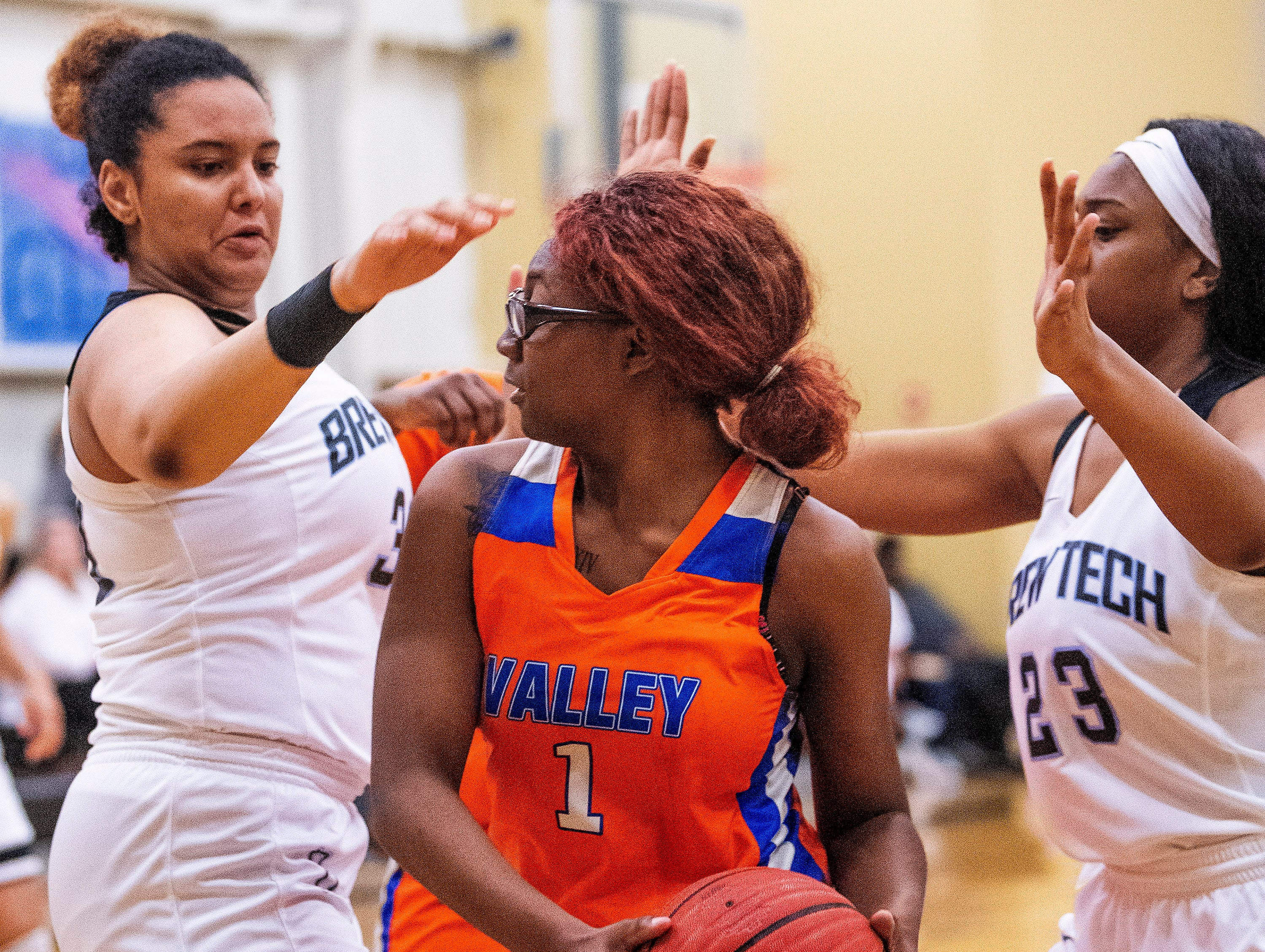 Valley's Starbresha Core (1) is double teamed by Brewbaker Tech's Jurnee Webster (30) and Brewbaker Tech's Kayla Williams (23) at the BrewTech campus in Montgomery, Ala., on Thursday February 7, 2019.